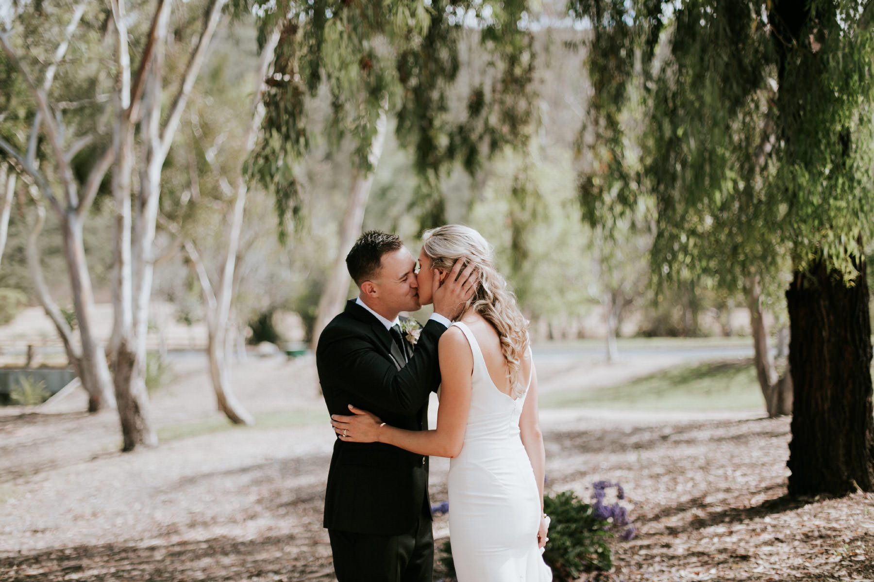 Bride and groom kissing during first look