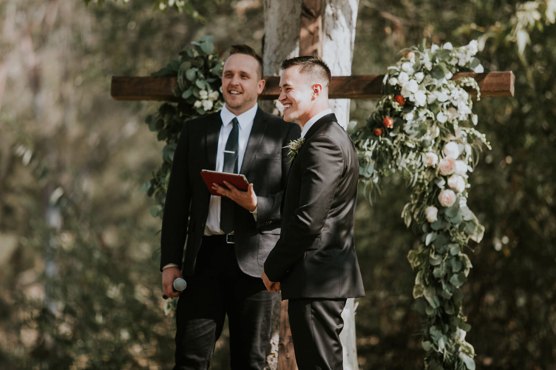 Groomsmen laughing at the altar