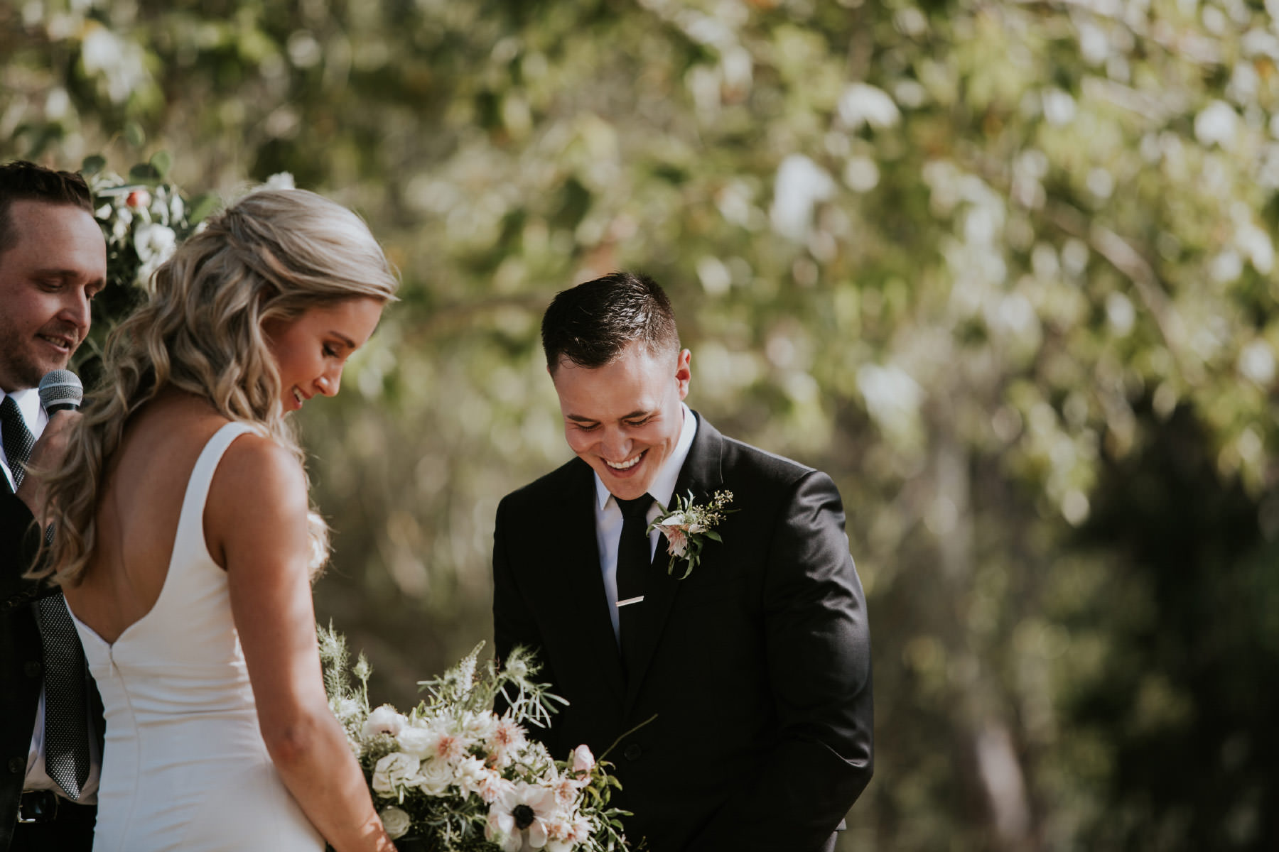 Groom laughing during outdoor ceremony in San Diego