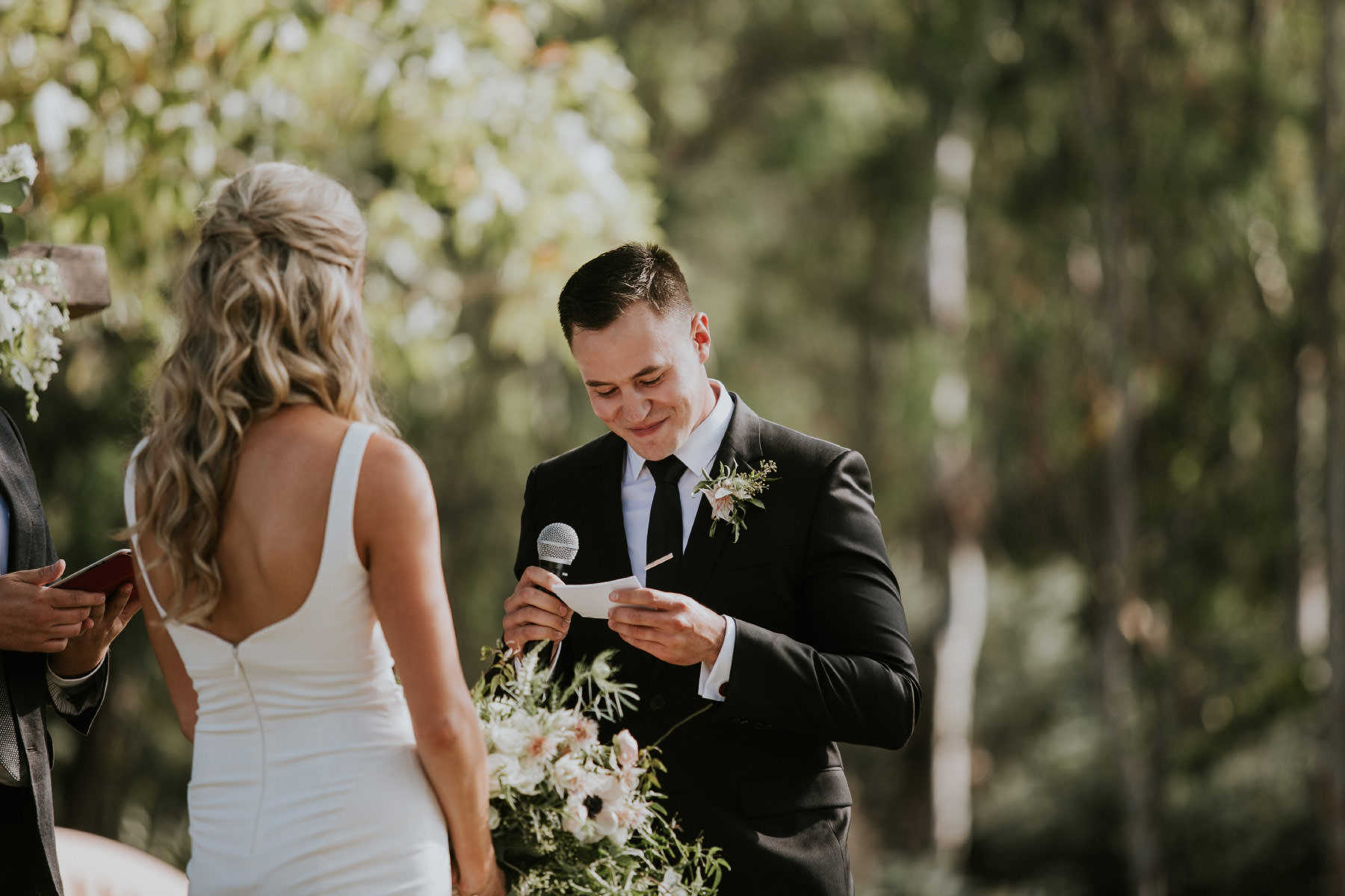 Groom reading his vows in outdoor ceremony in San Diego