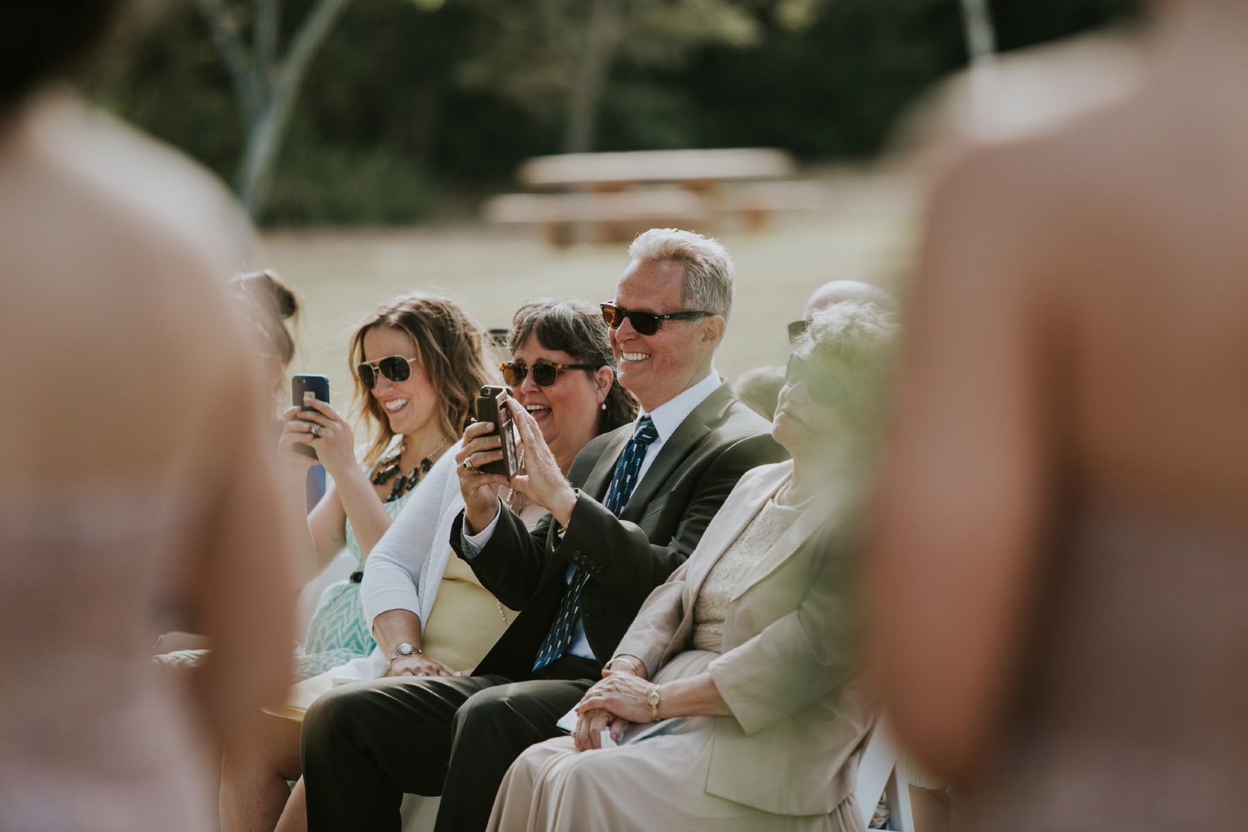 Family taking iPhone photos during ceremony
