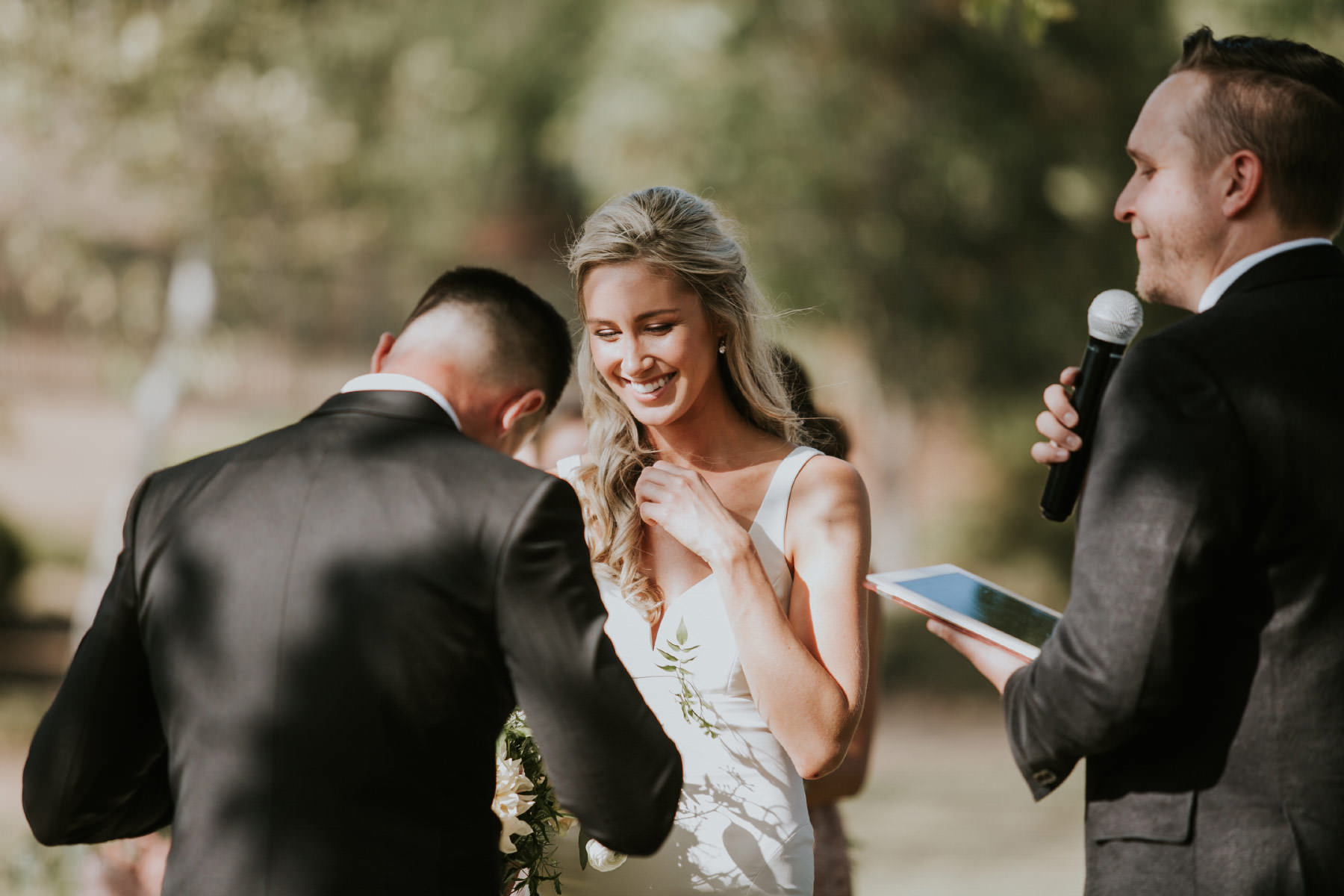 Bride and groom laughing during ceremony in Rancho Santa Fe