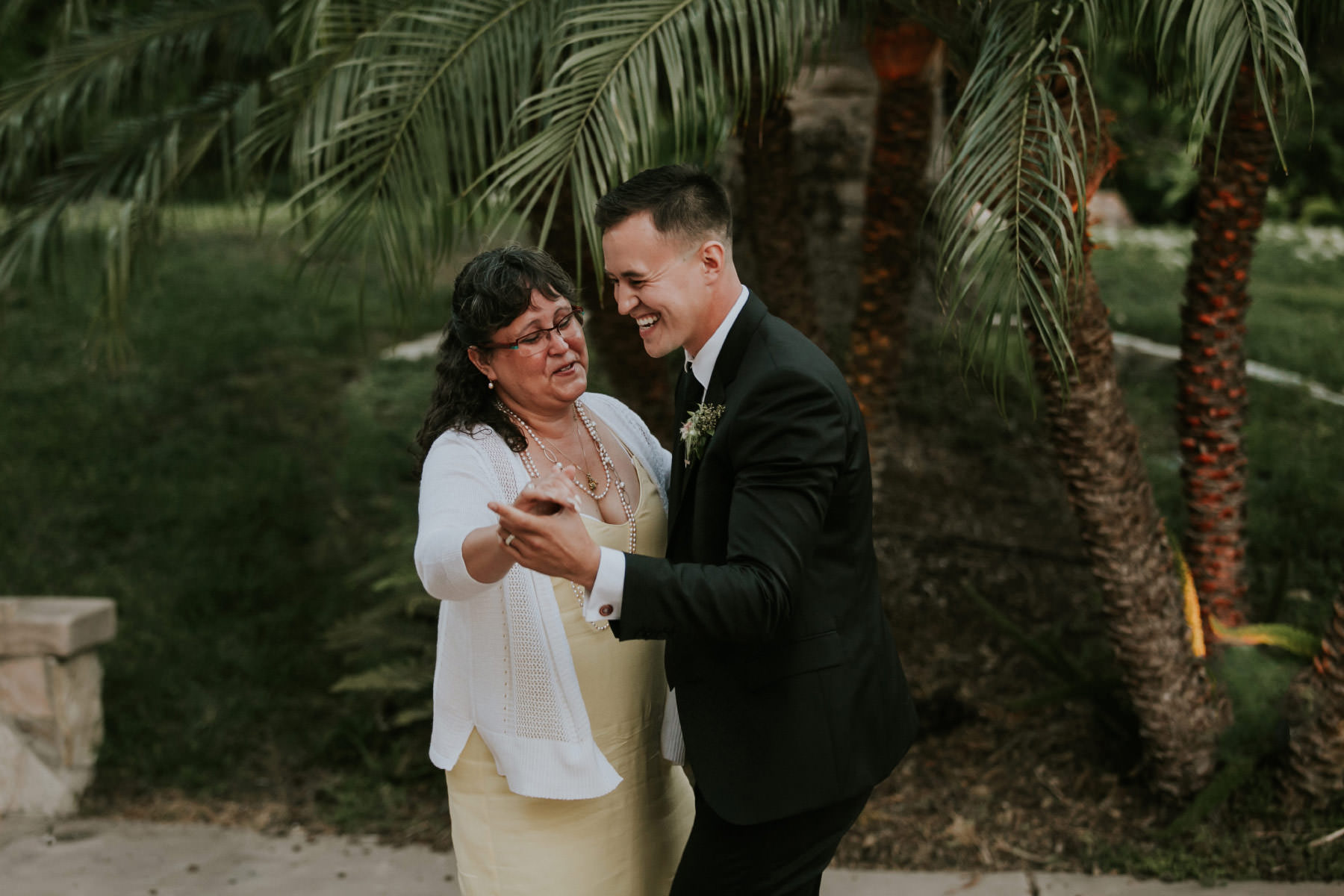 Mother and son dancing at San Diego backyard wedding
