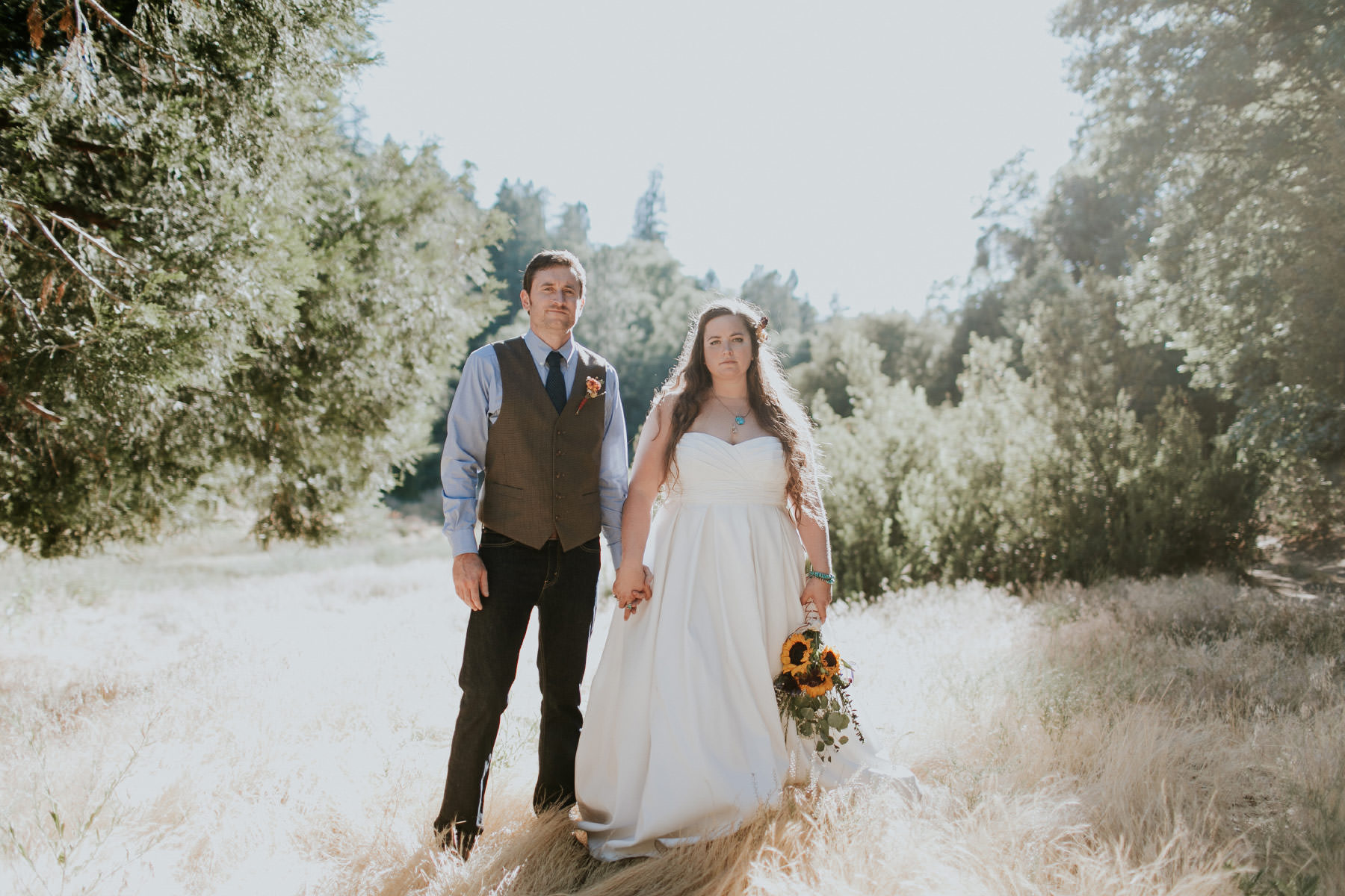 Boho bride and groom editorial in rustic woodland setting at Baileys Palomar Resort