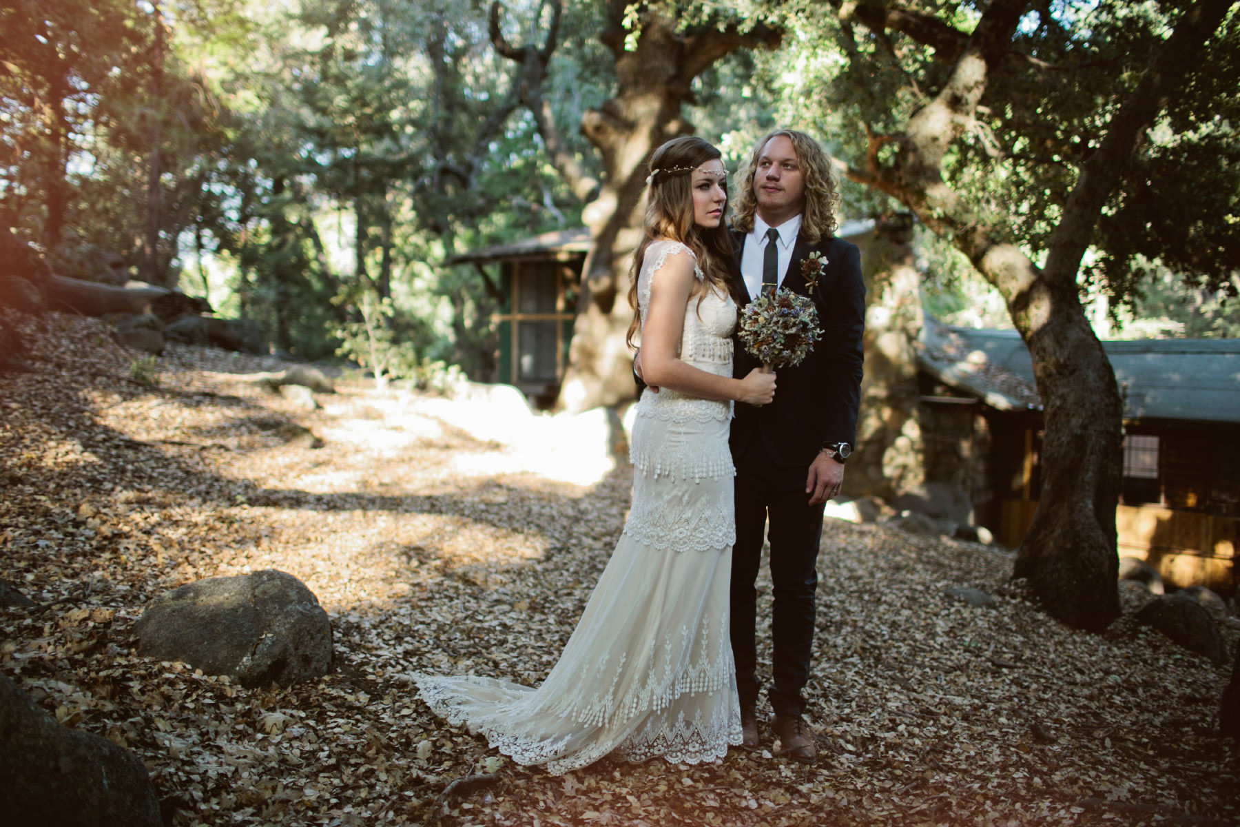 Boho bride and groom in the Baileys Palomar Resort oak grove