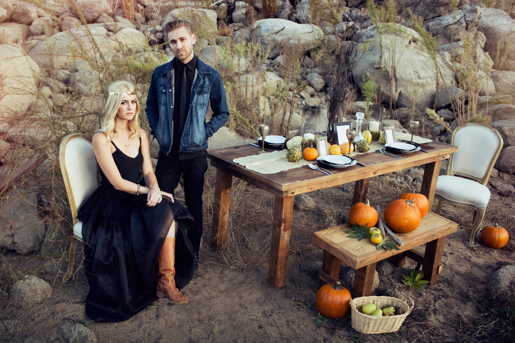 Rustic farm tables decorated for Halloween with pumpkins and harvest colors