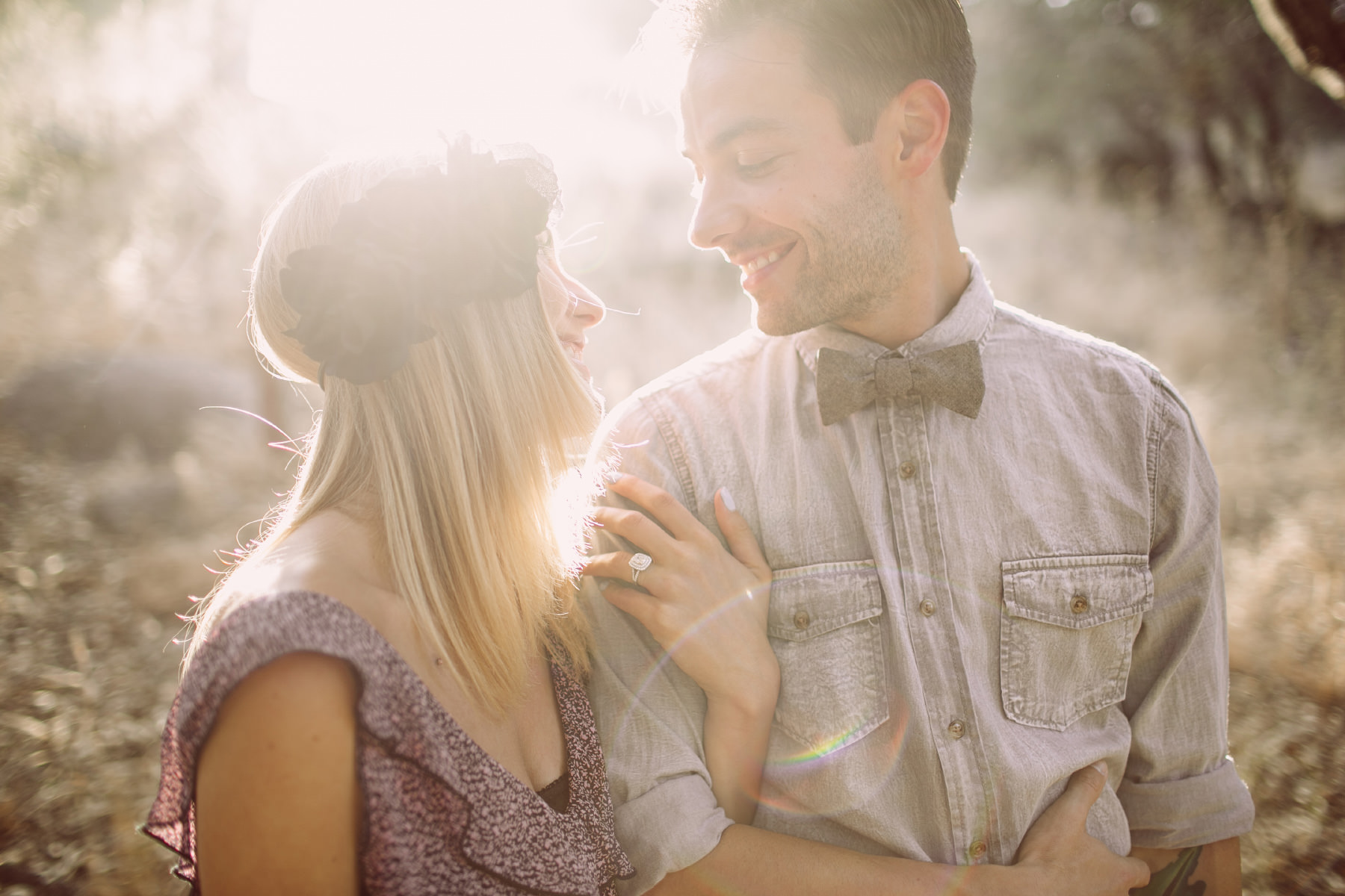 Cute couple smiling at each other with intense sun flares