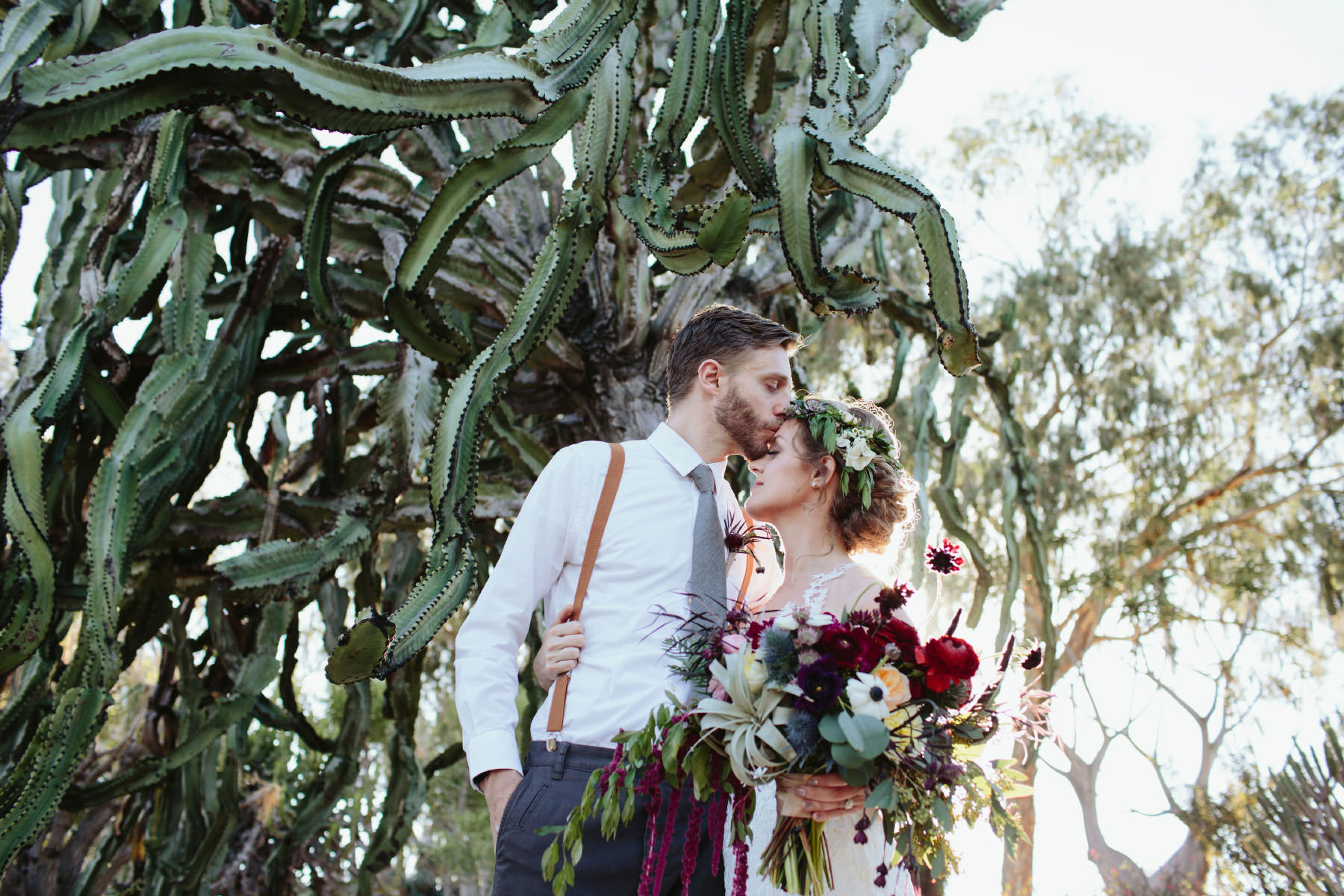 Couple kissing after their wedding at the Balboa Park Cactus Garden