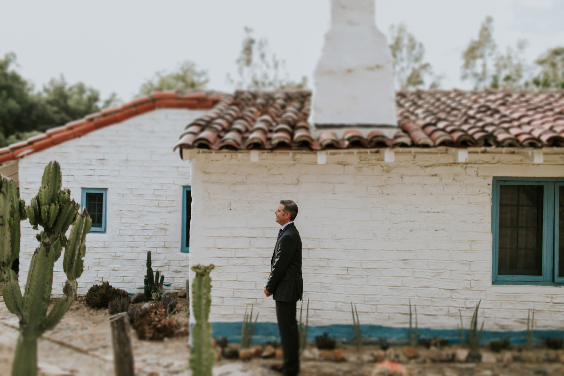 Groom waiting for first look at Leo Carrillo Ranch wedding