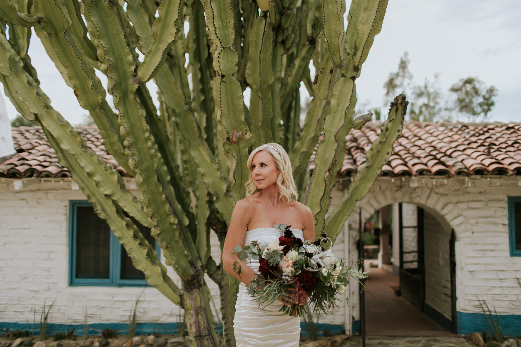 Beautiful bride posing in front of cactus at Leo Carrillo Ranch