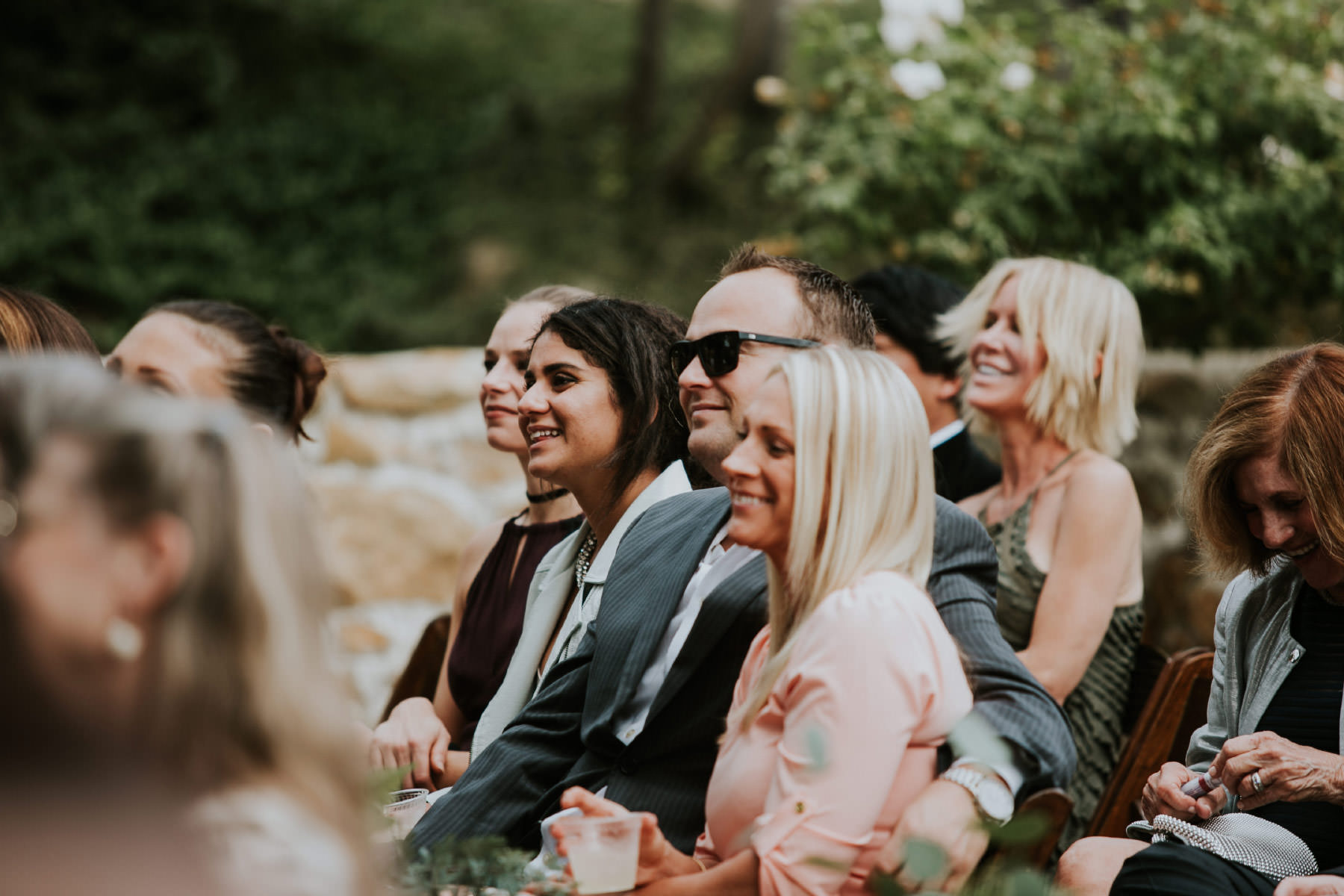 Guests laughing during ceremony