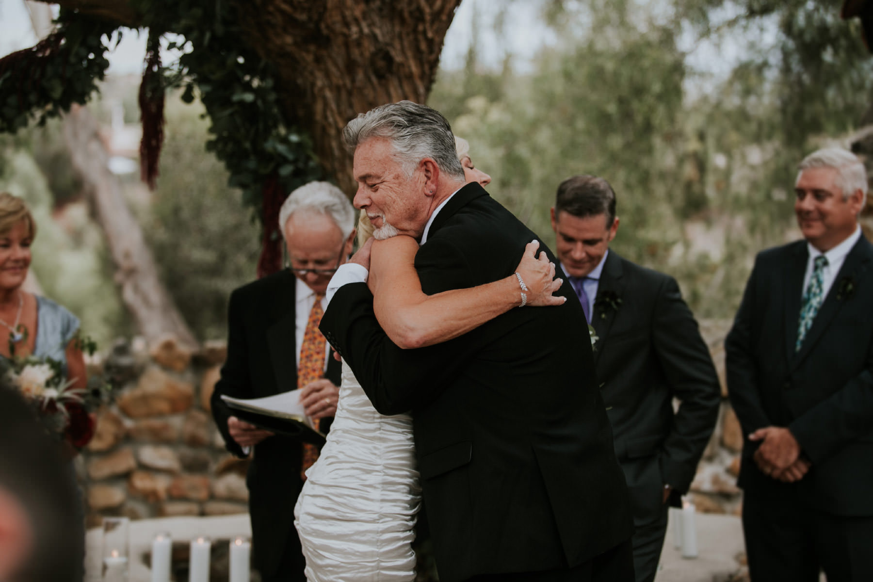 Bride and brother hugging during ceremony
