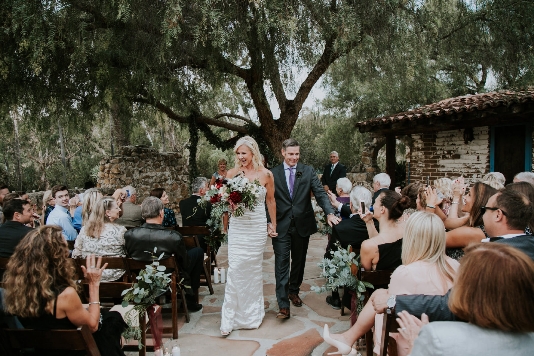 Bride and groom coming down the aisle at Leo Carrillo Ranch