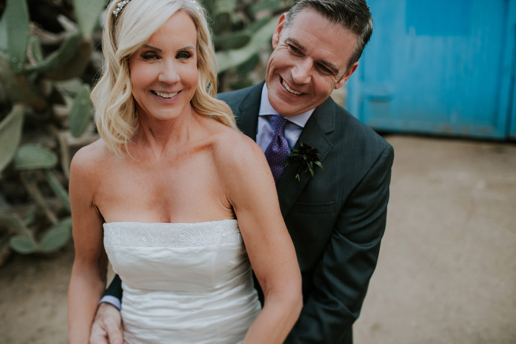 Bride and groom laughing at Leo Carrillo Ranch