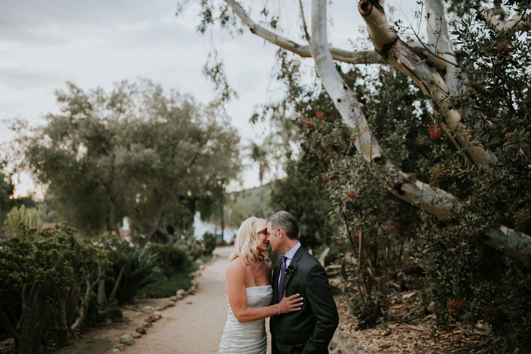 Bride and groom kissing at sunset at Leo Carrillo Ranch