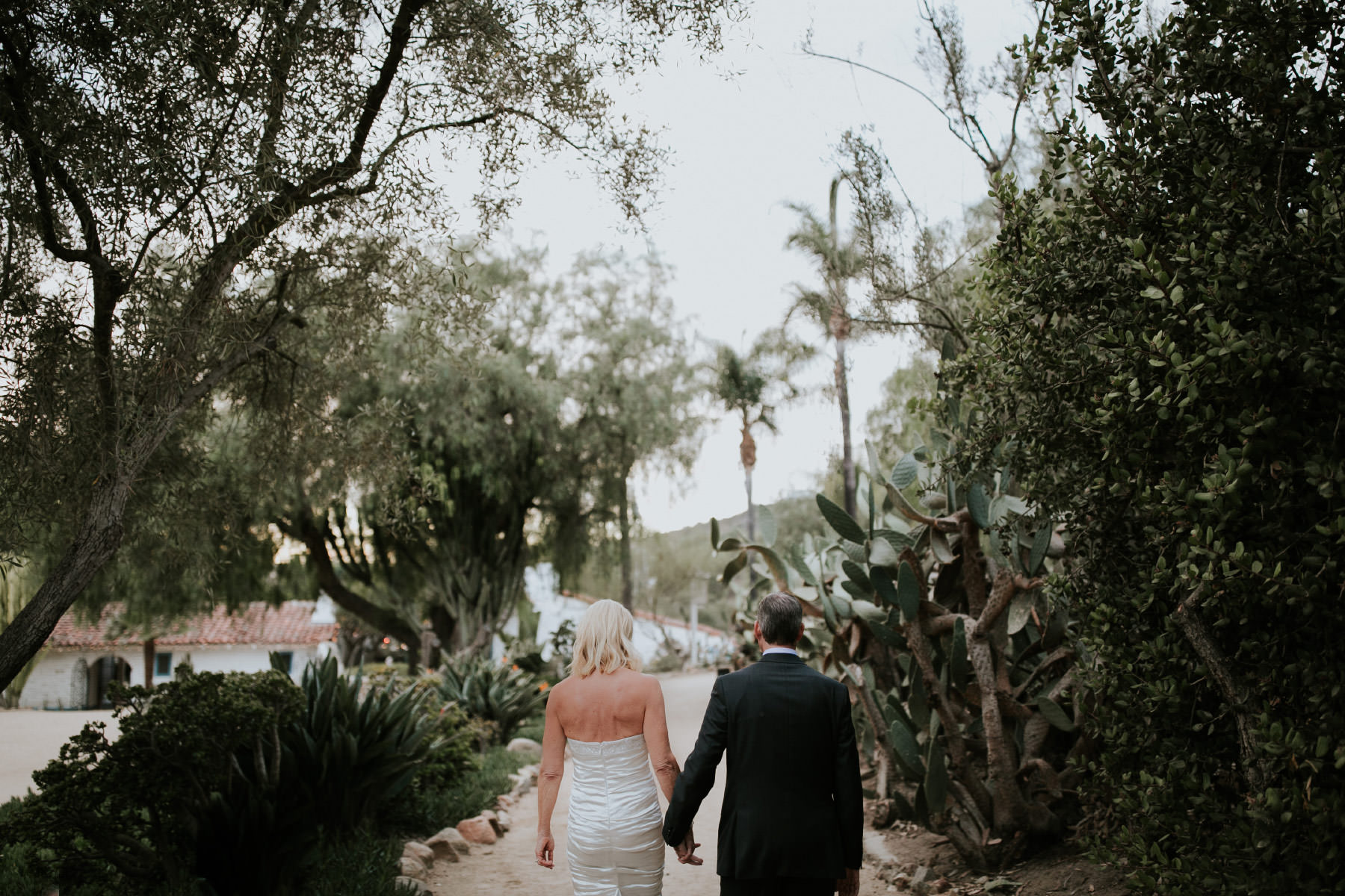 Bride and groom walking away at Leo Carrillo Ranch