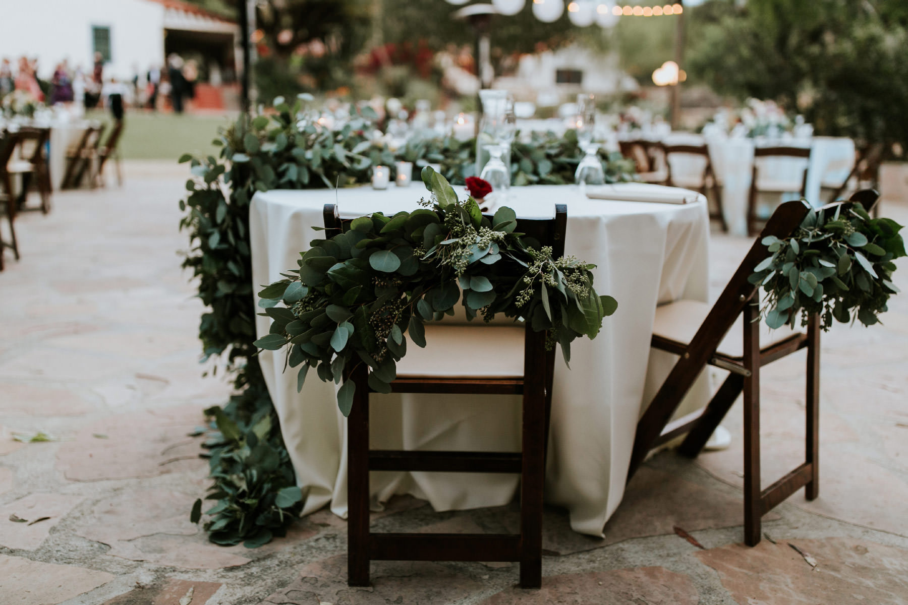 Eucalyptus garland on sweetheart table chairs