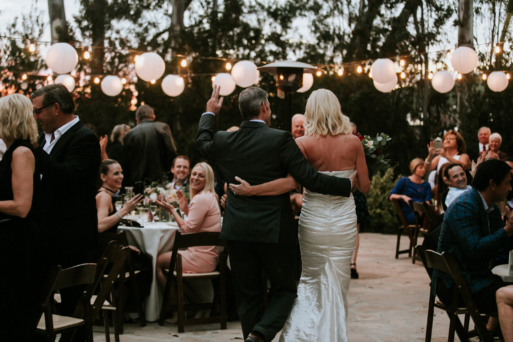 Bride and groom entering reception at Leo Carrillo Ranch wedding