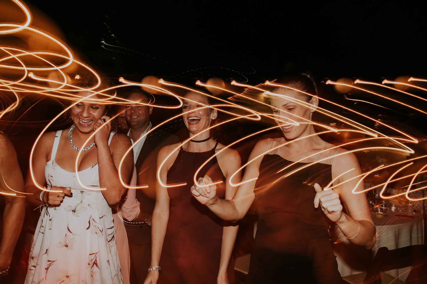 Light drag with wedding guests dancing