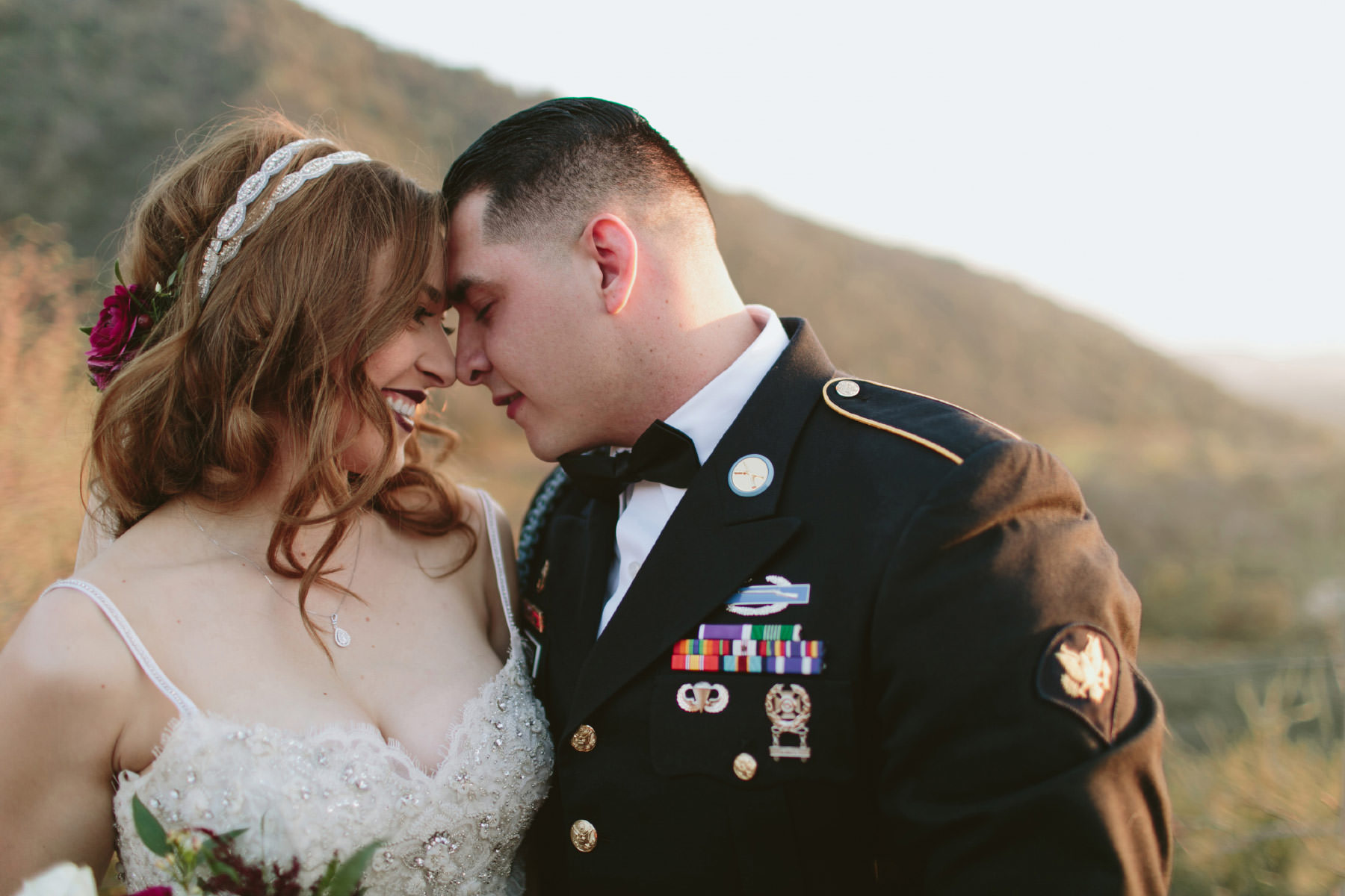 Military couple kissing during golden hour at Serendipity Gardens