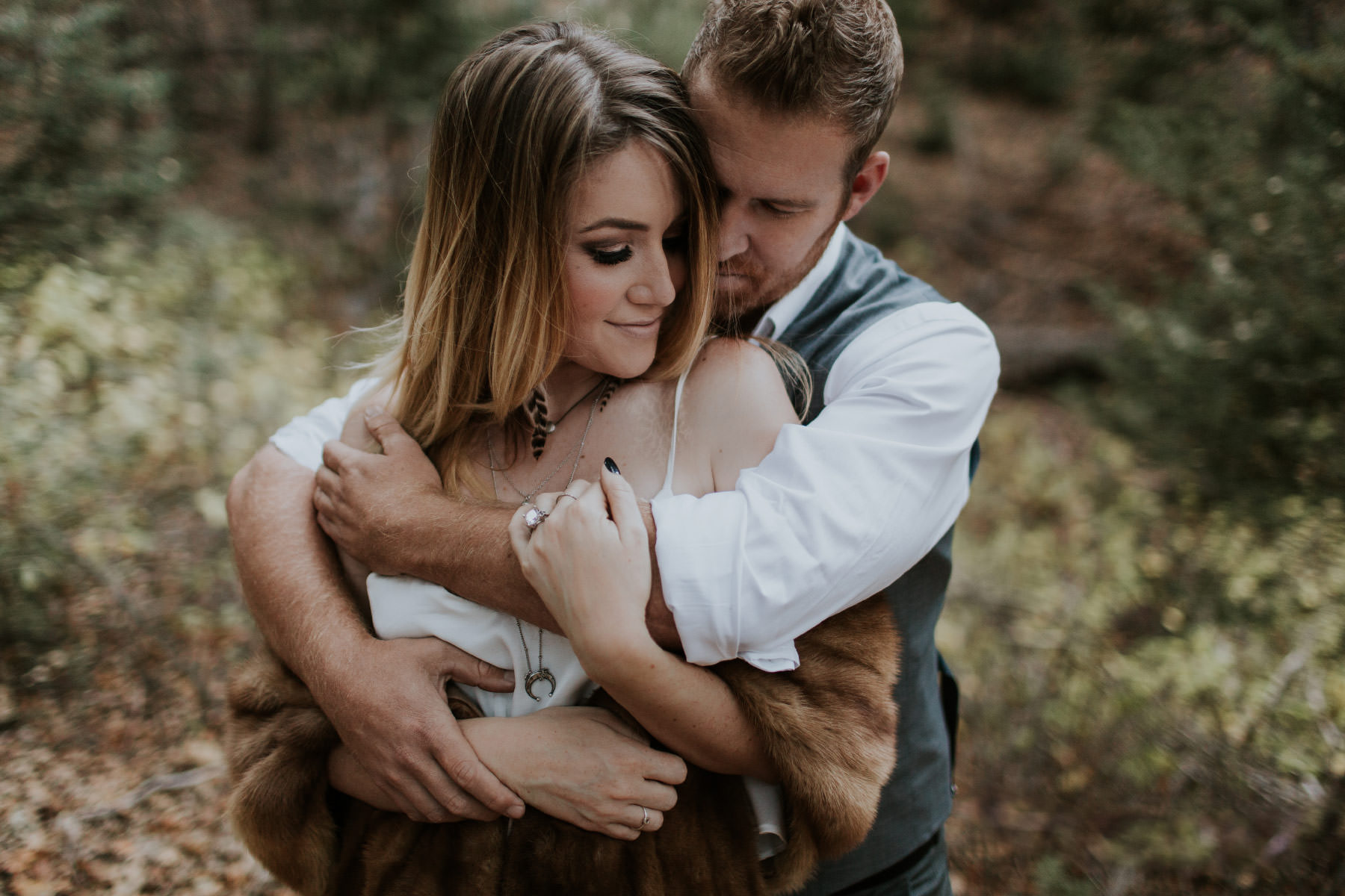 Couple embracing in forest at Palomar Mountain