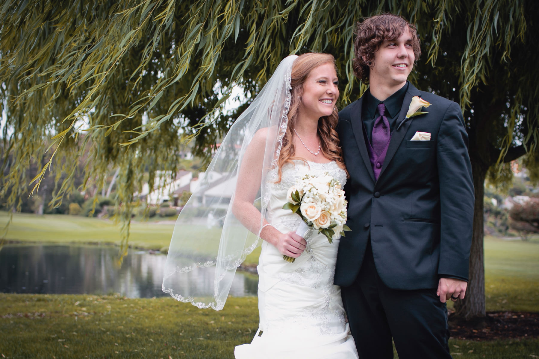 Bride and groom by a willow tree at El Camino Country Club