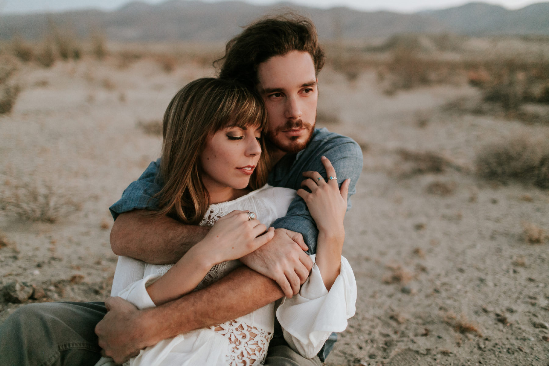 Adventurous couple cuddling during blue hour in the Anza Borrego Desert