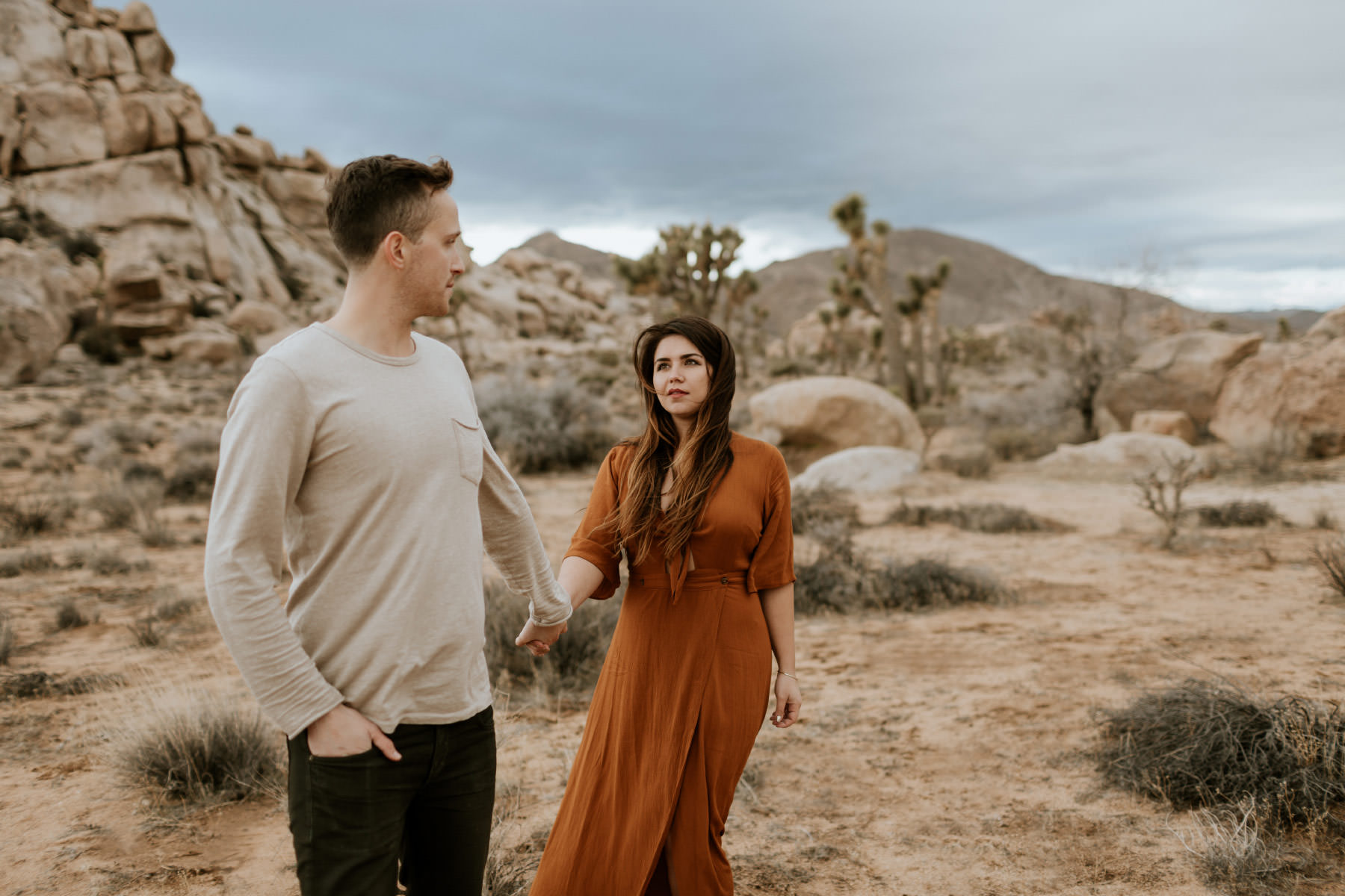 Windy and adventurous engagement session at Joshua Tree
