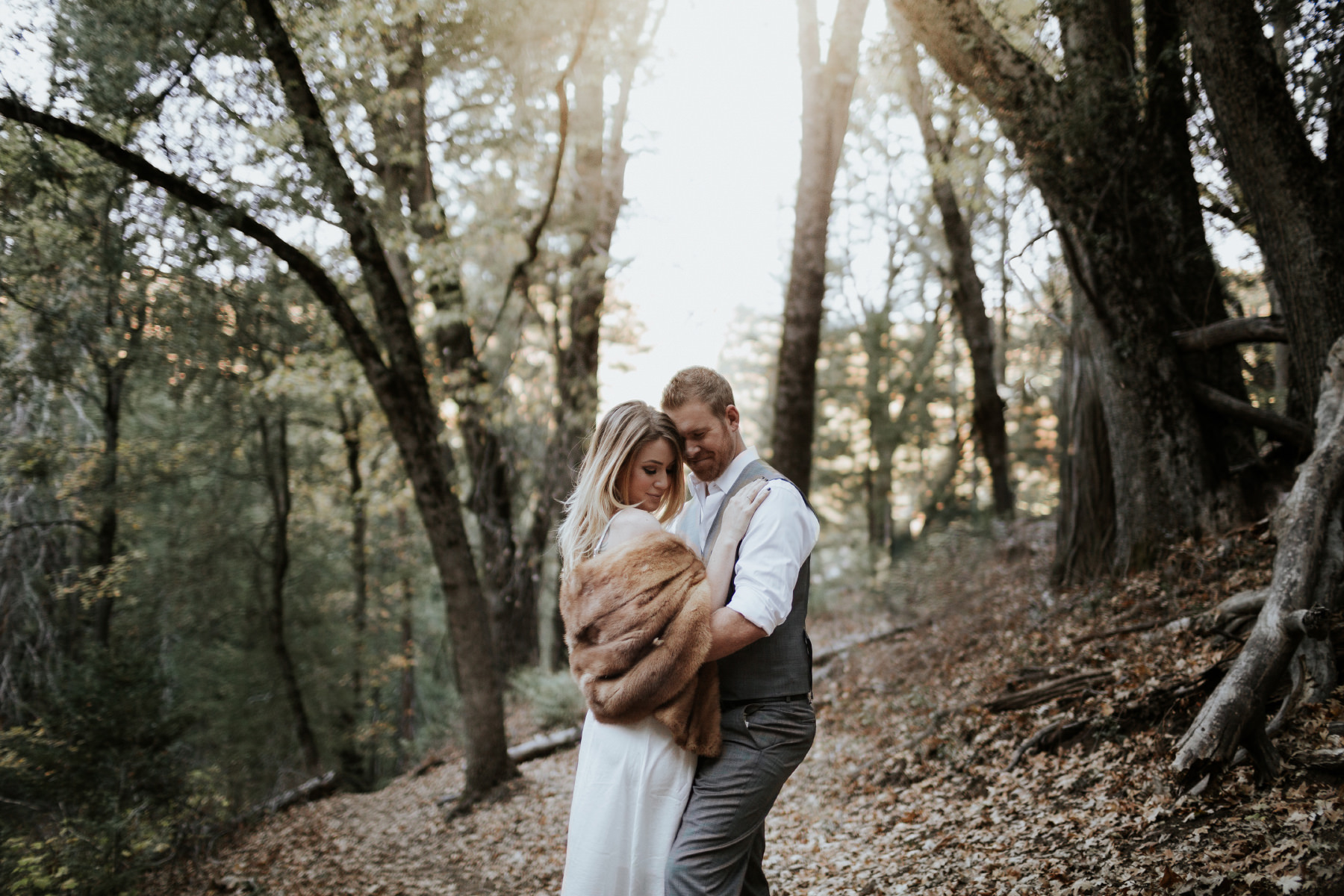 Engaged couple embracing in the woods at Palomar Mountain