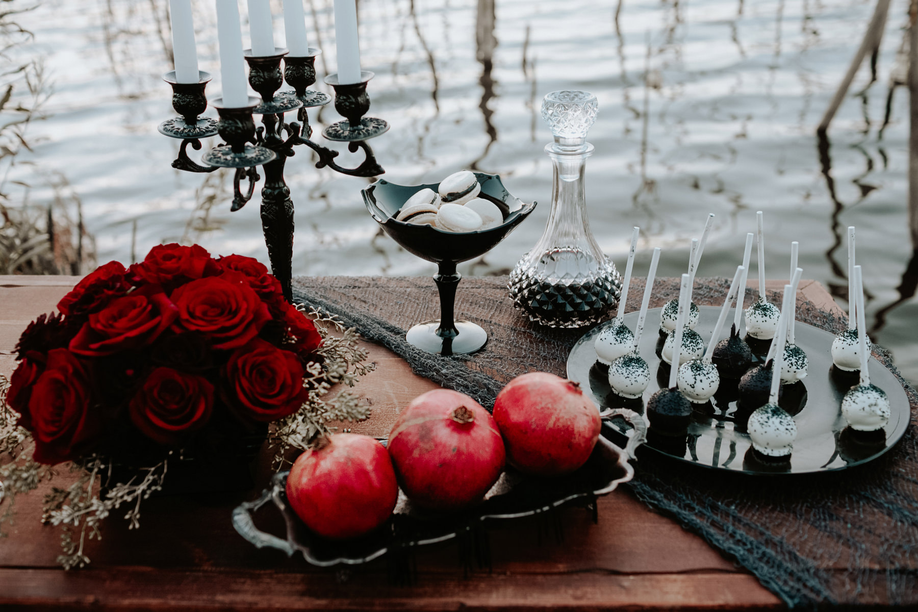Halloween tablescape featuring pomegranates and dark cake pops