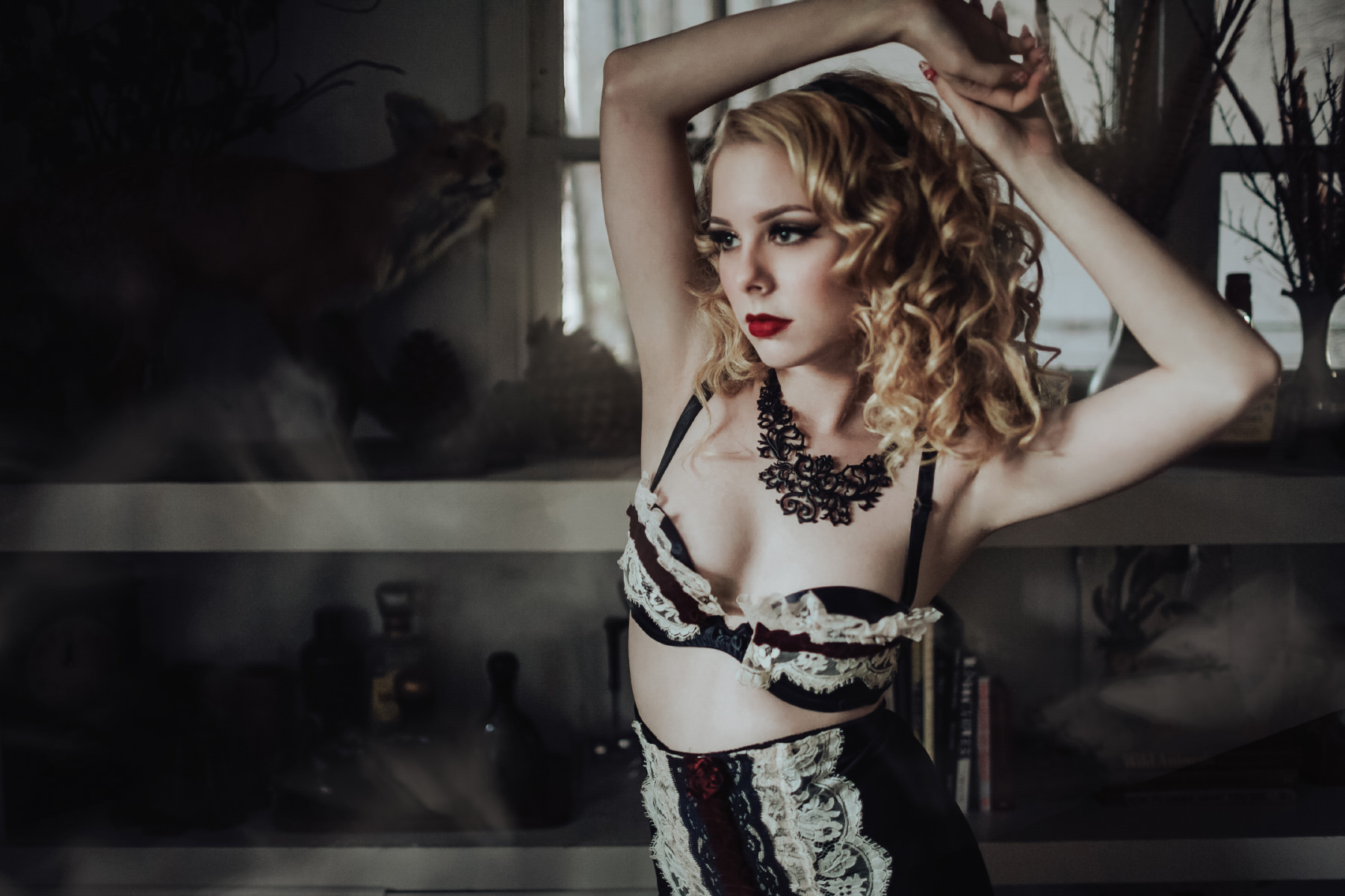 Alternative model Jacquelyne Marie posing in dark lingerie with taxidermy