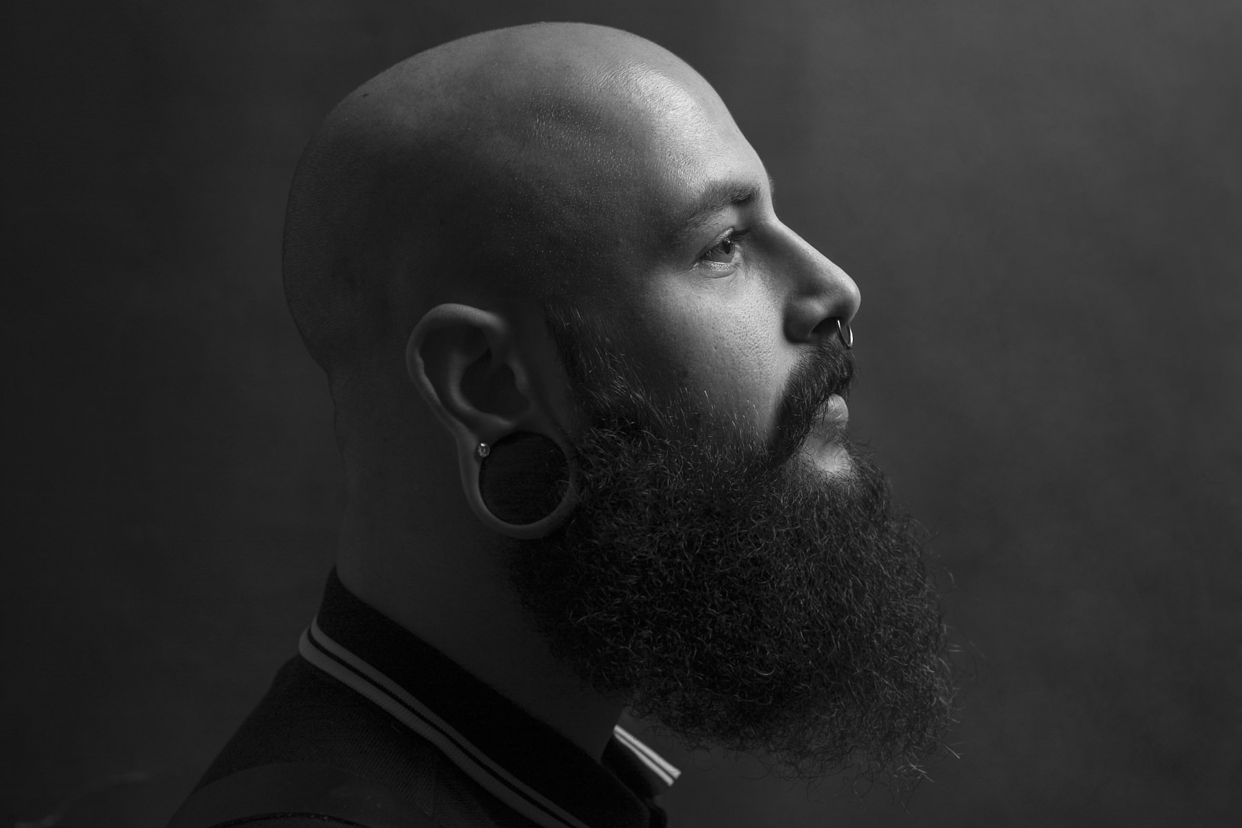 Tattooed and bearded Being As An Ocean singer Joel Quartuccio posing for HM magazine cover