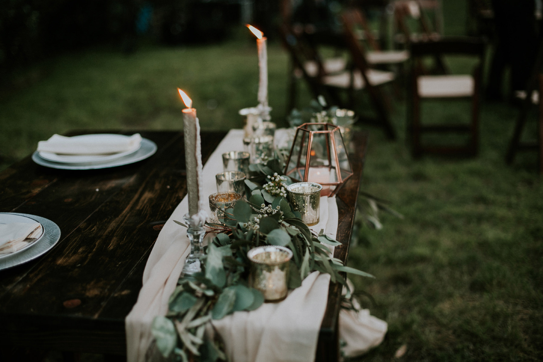 Eucalyptus greenery runner on sweetheart table with mercury glass tea lights