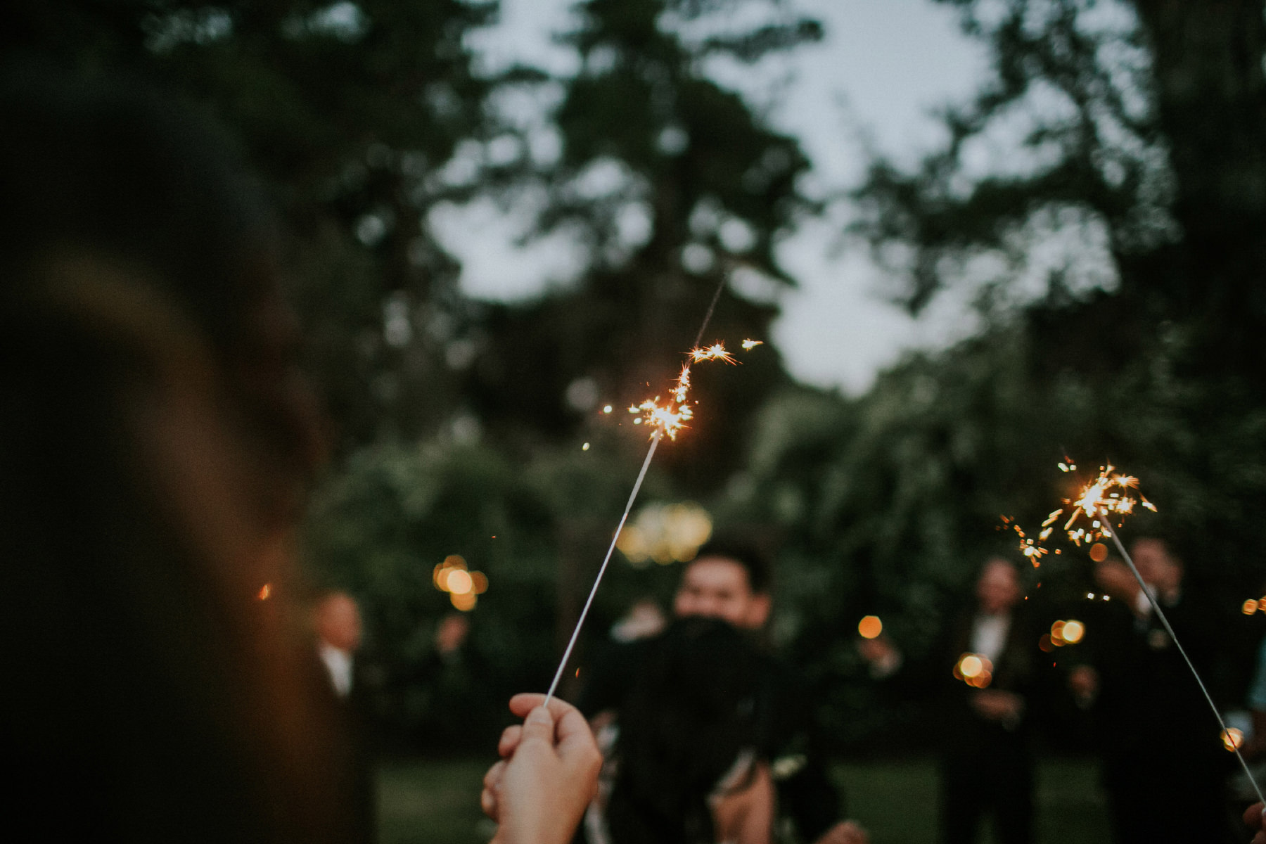 Sparklers during the bride and groom first dance at San Diego backyard wedding