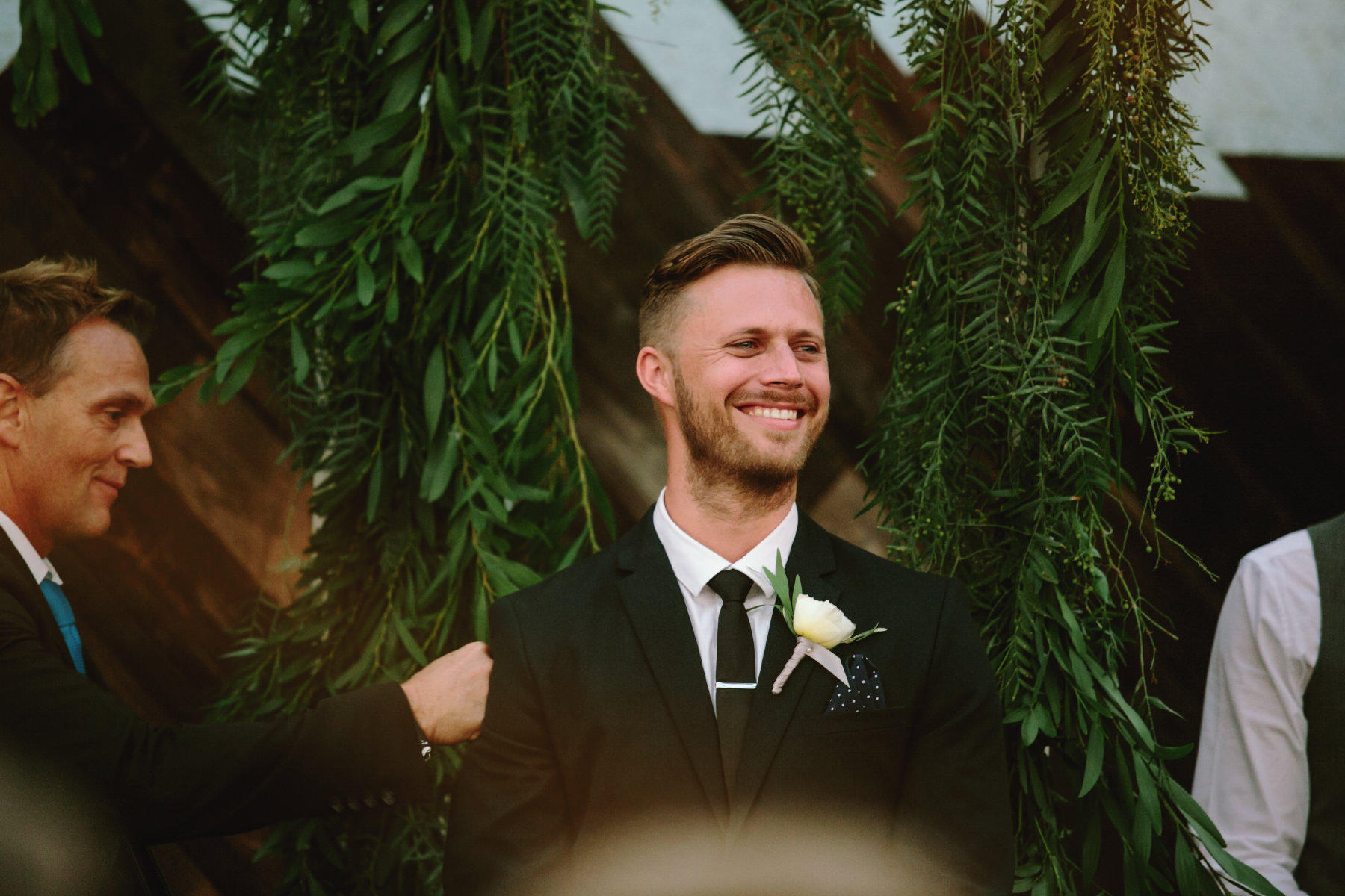 Teary eyed groom see his bride coming down the aisle at Booze Brothers wedding