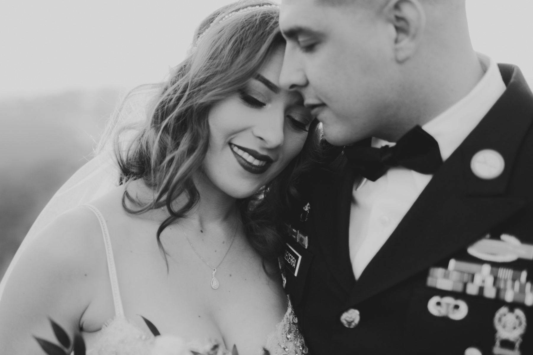 Intimate black and white portrait of bride and groom at Serendipity Garden