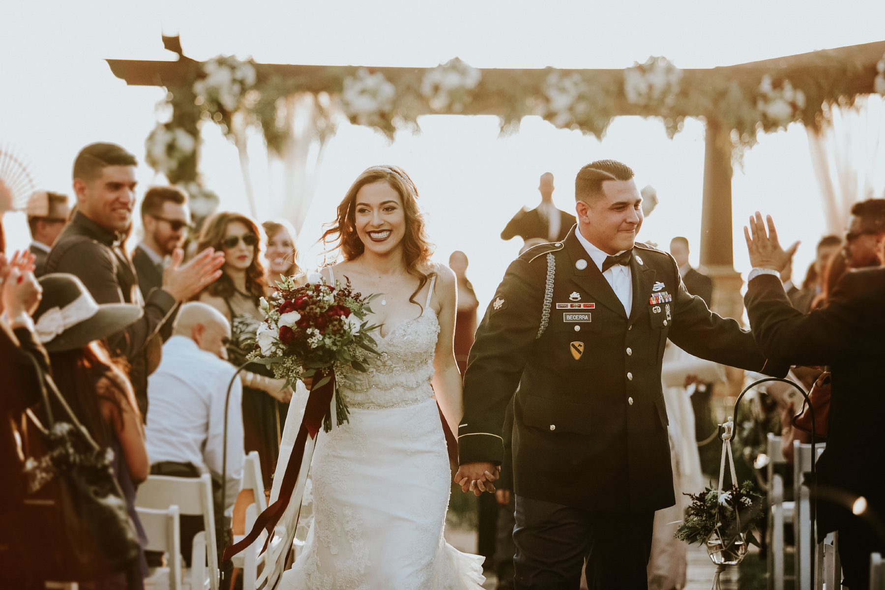 Bride and groom coming down the aisle during golden hour at Serendipity Garden