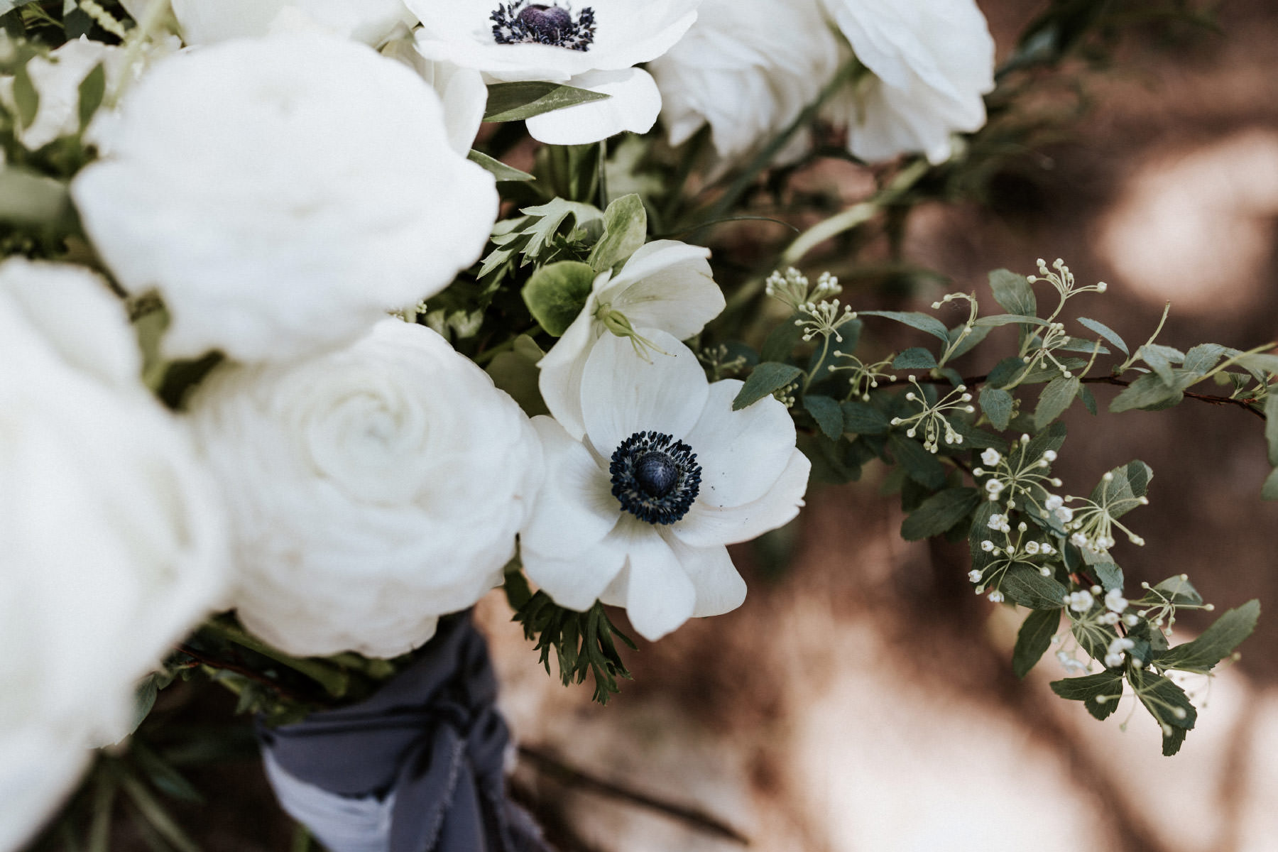 White anemone and roses in bridal bouquet