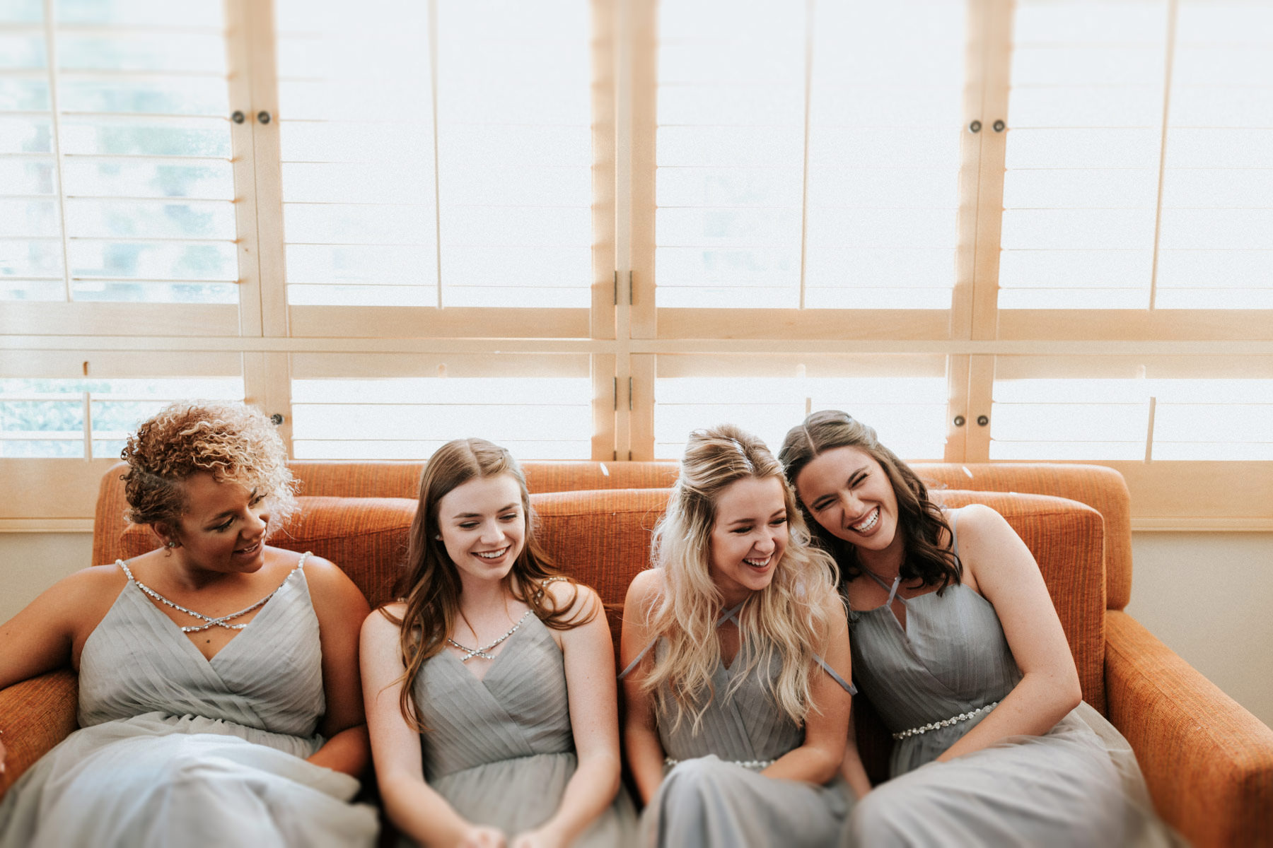 Bridesmaids laughing in getting ready suite