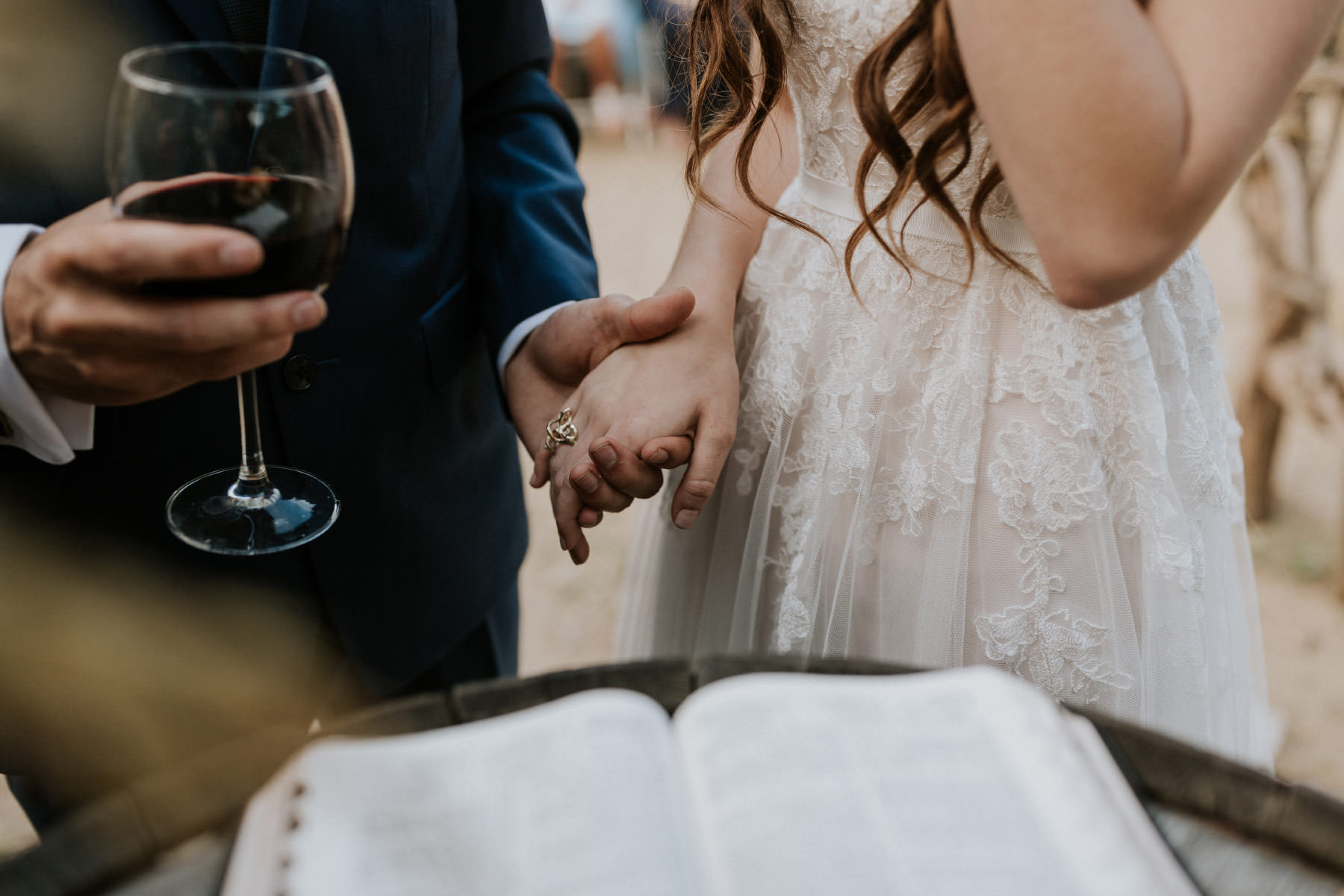 Bride and groom holding hands during communion
