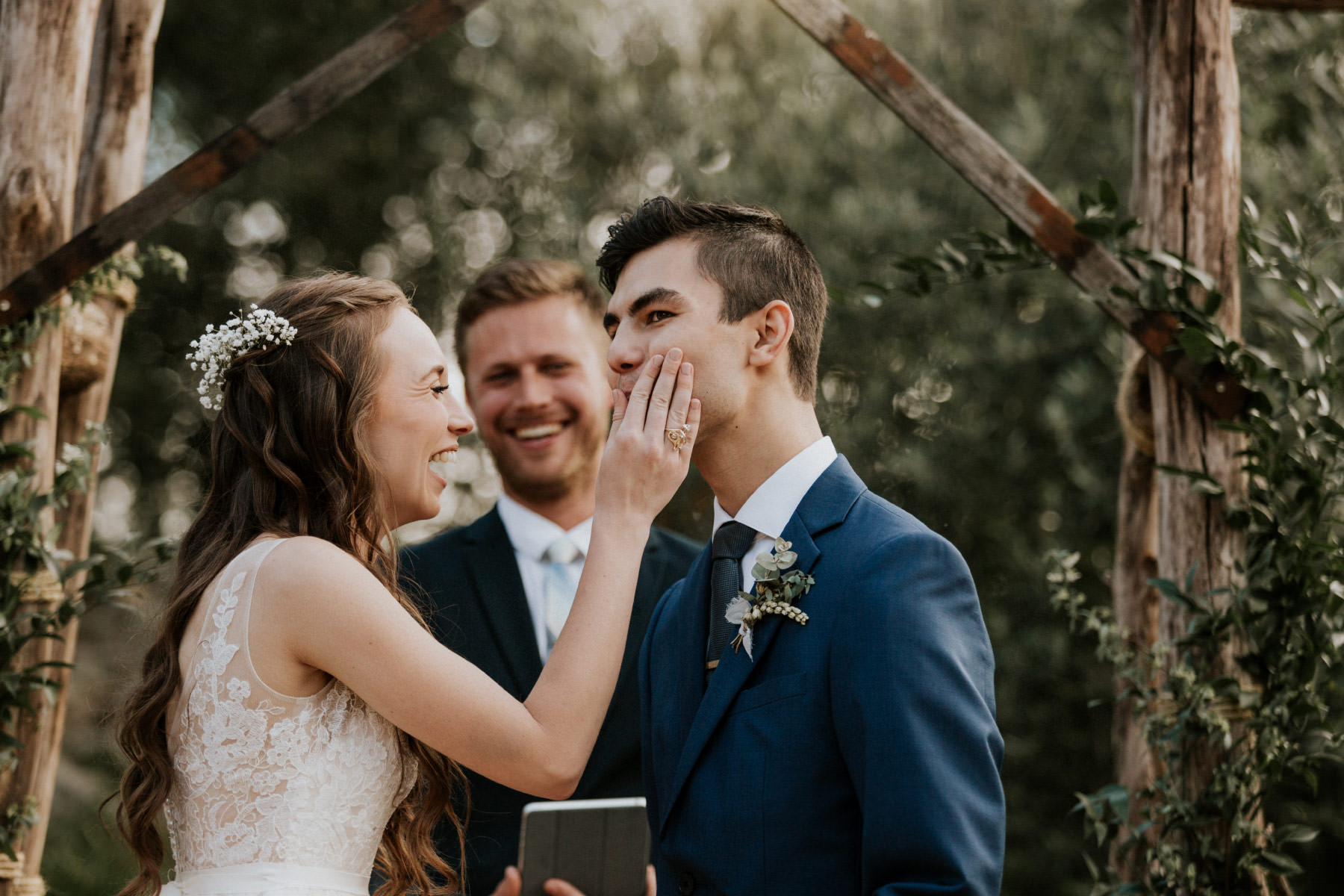 Bride wiping grooms lips after first kiss