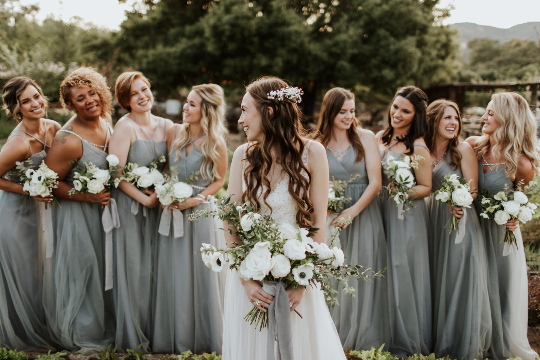 Bridesmaids in dusty blue maxi dresses