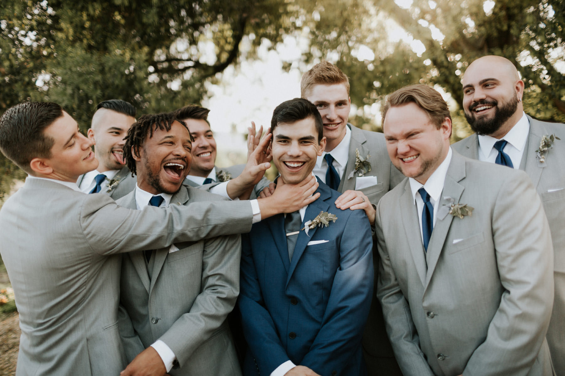 Groomsmen messing with the groom