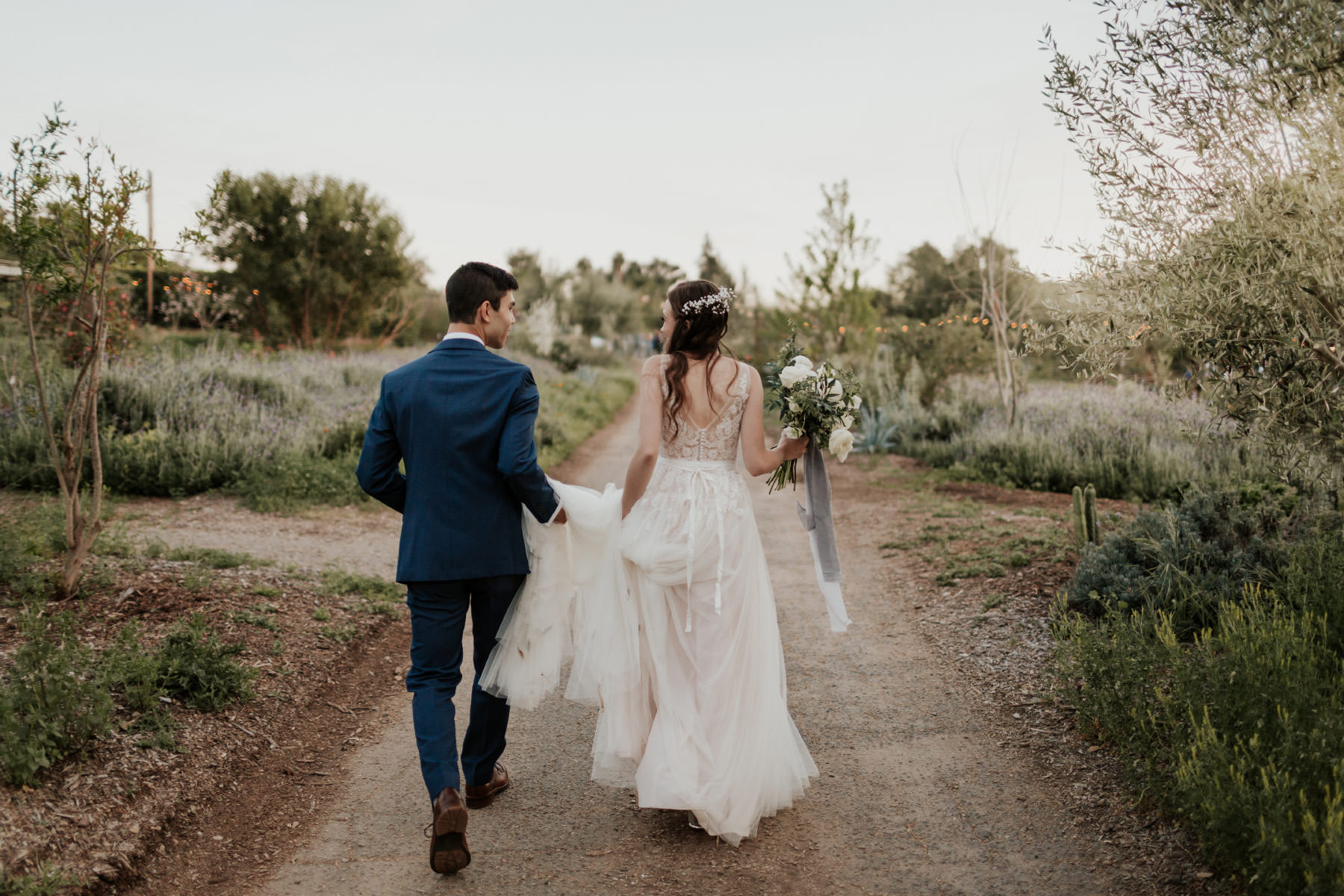 Bride wearing BHLDN lace dress