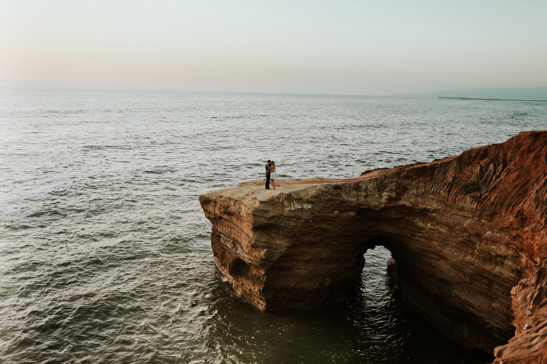 Engagement session on the Arch at Sunset Cliffs