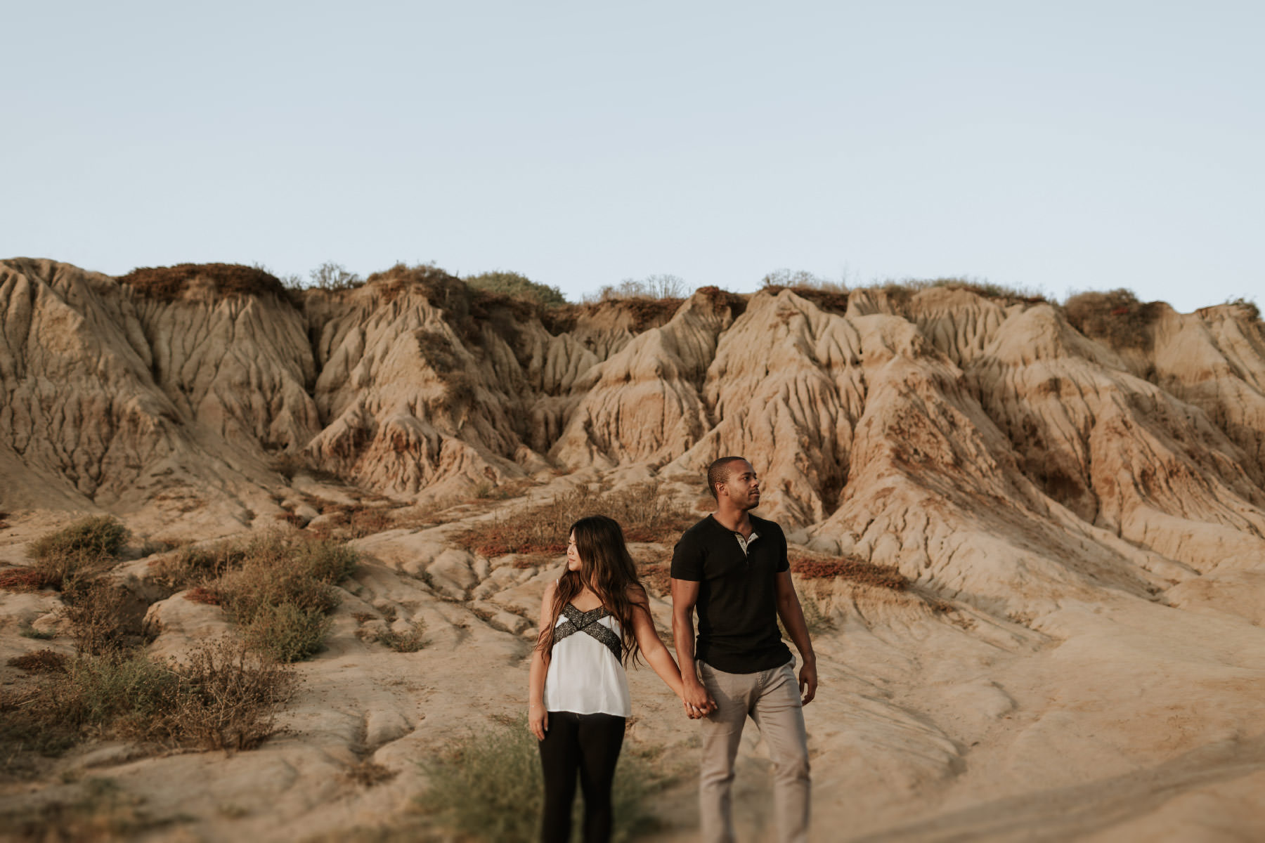 Couple standing in Sunset Cliffs badlands
