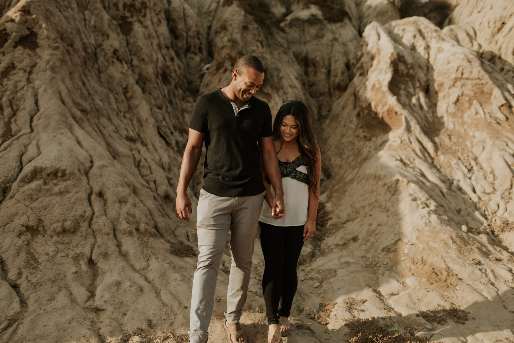 Couple walking in Sunset Cliffs canyons