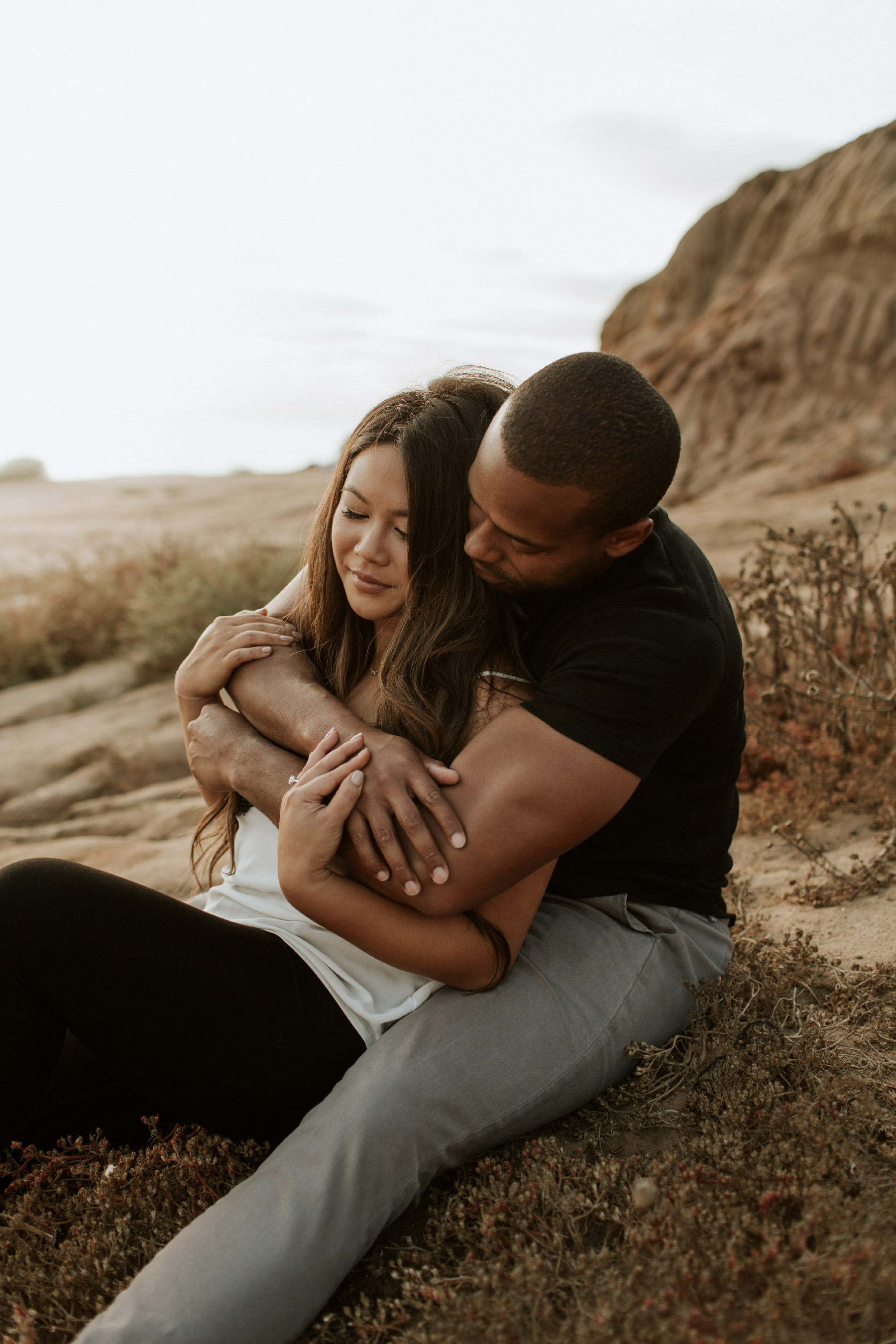 Couple embracing in Sunset Cliffs engagement session