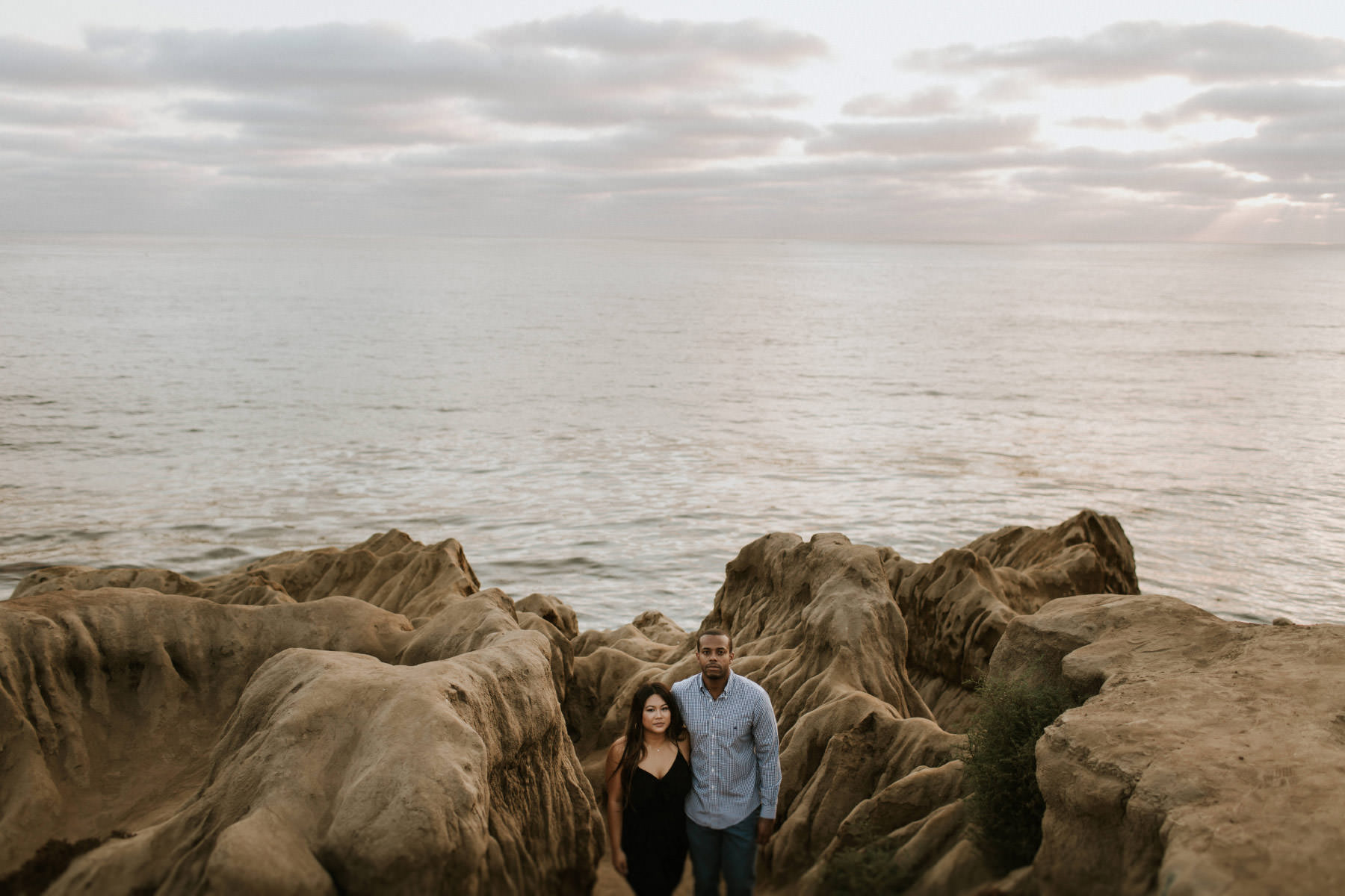 Couple standing in Sunset Cliffs canyons