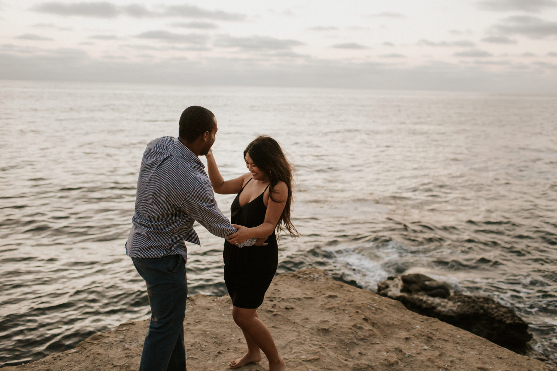 Couple dancing at sunset cliffs